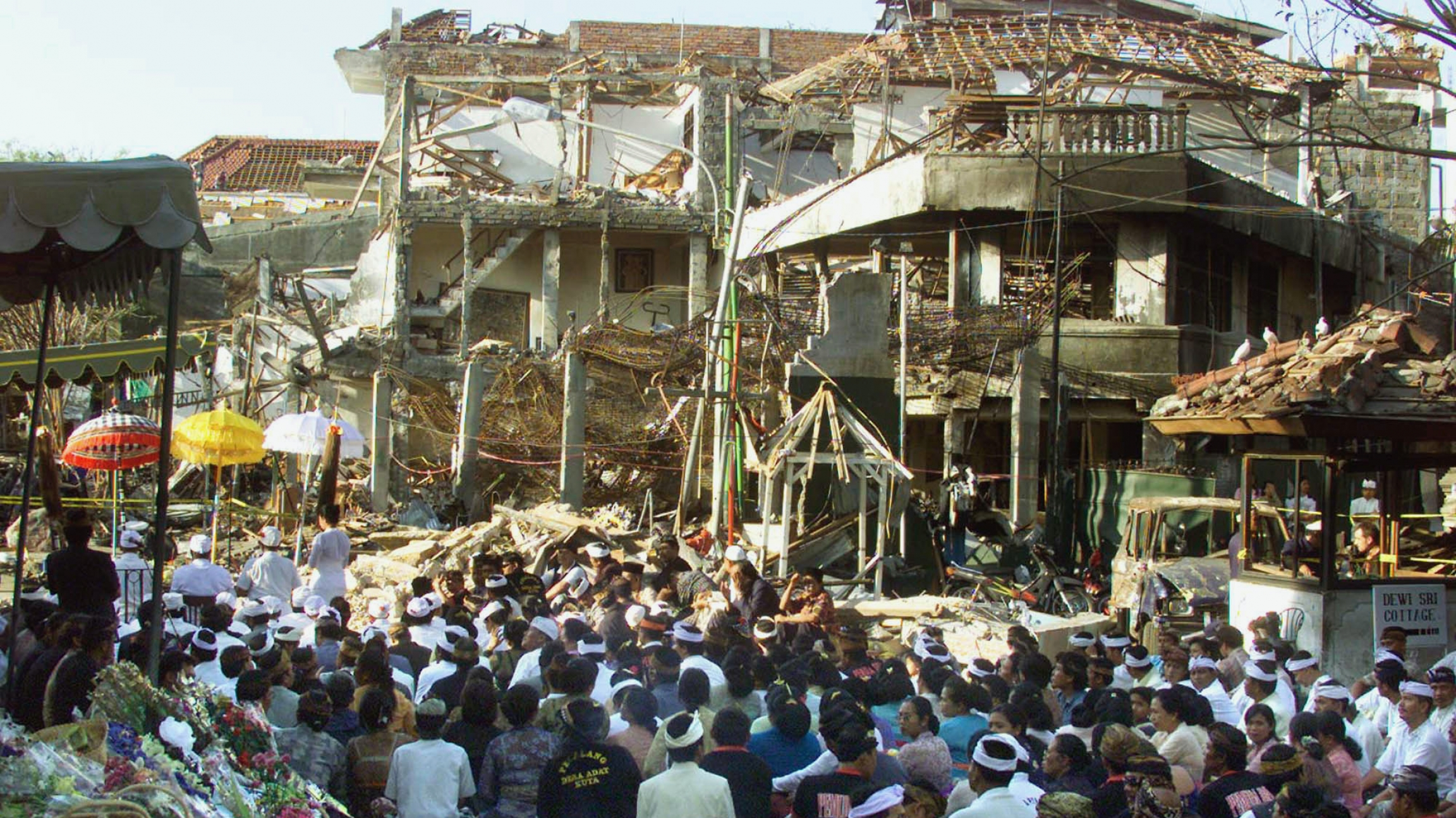 Local Balinese offer prayers for the victims at the site of the bomb blast in Kuta, Bali, Oct. 18, 2002. Nearly 200 people were killed and more than 300 were injured in the nightclub bombing.