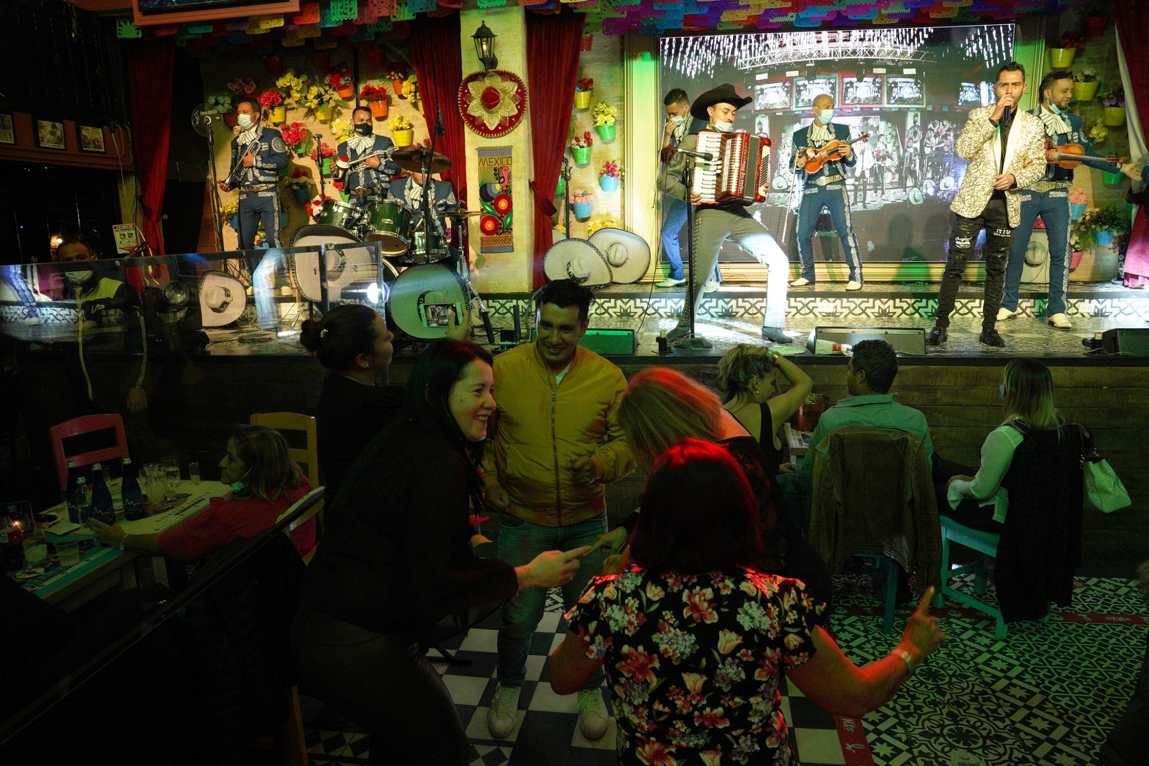 People mingle at thePlaza MX nightclub in Bogotá, Colombia