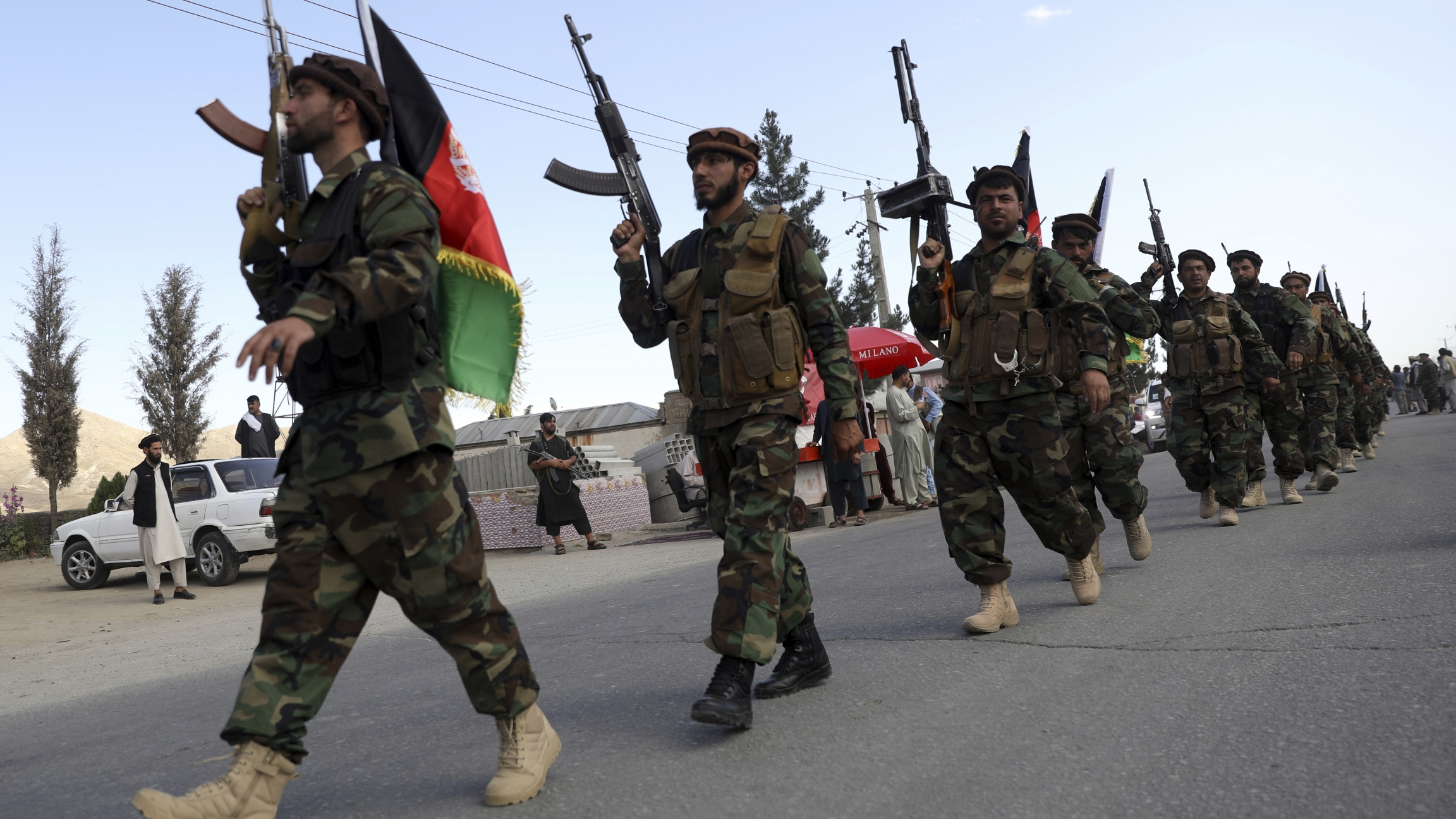 Afghan militiamen join Afghan defense and security forces during a gathering in Kabul, Afghanistan, Wednesday, June 23, 2021.