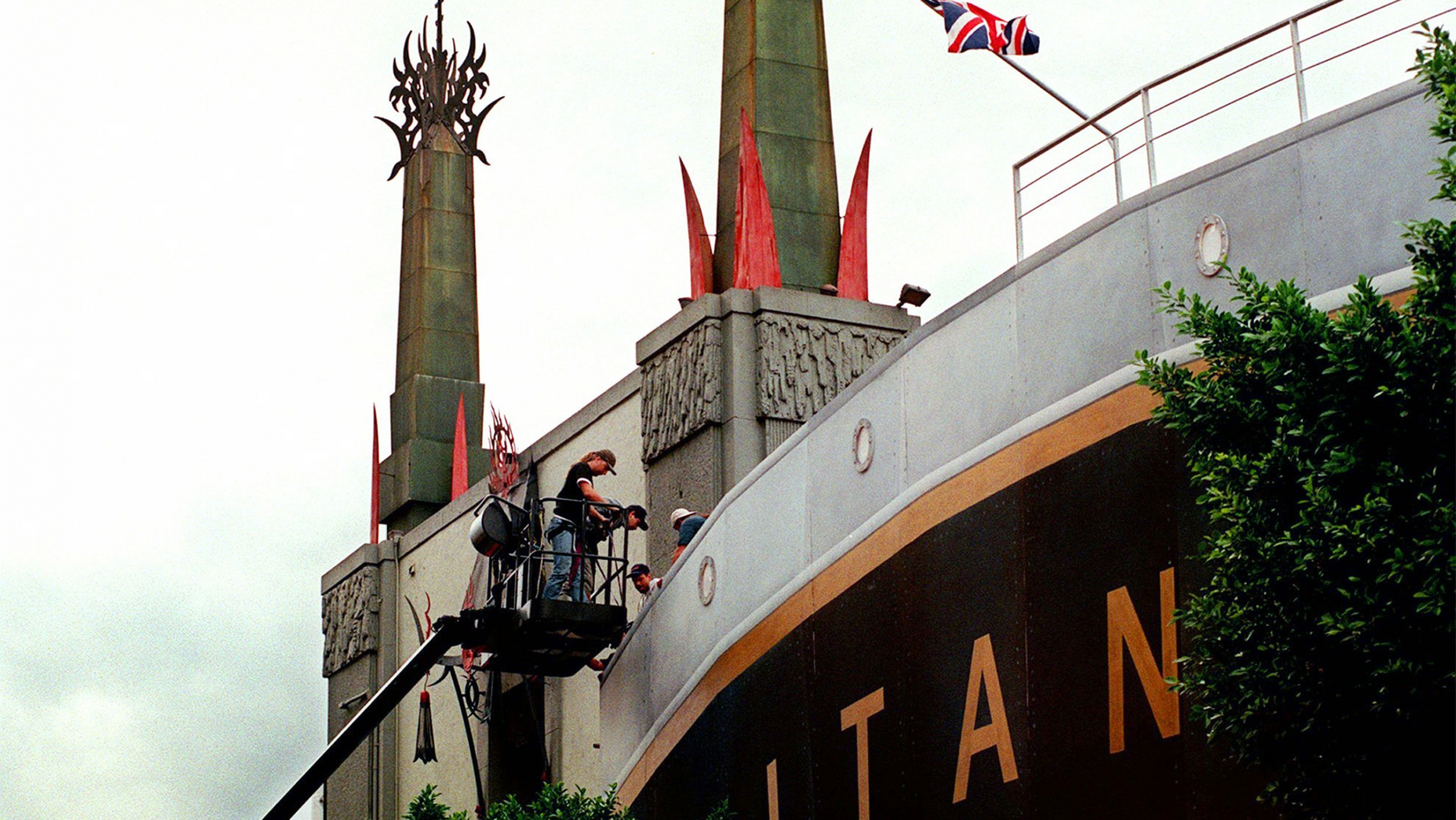 Men working on the facade of a Titanic replica in China