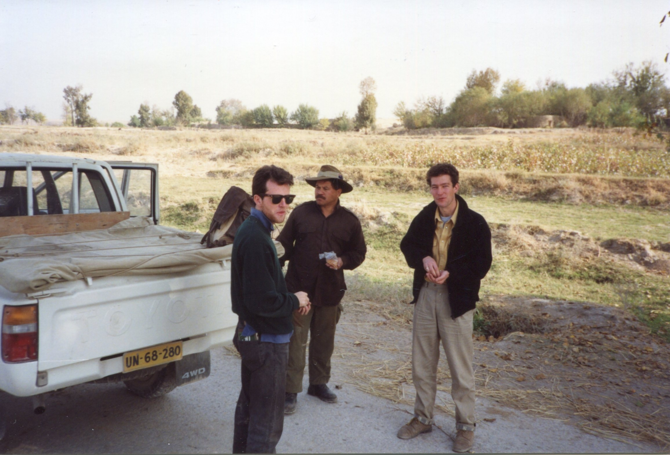 A pit stop in Baghlan Province, Afganistan, 1991. The BBC's Chris Bowers (right), with officials from The HALO Trust and the UN.