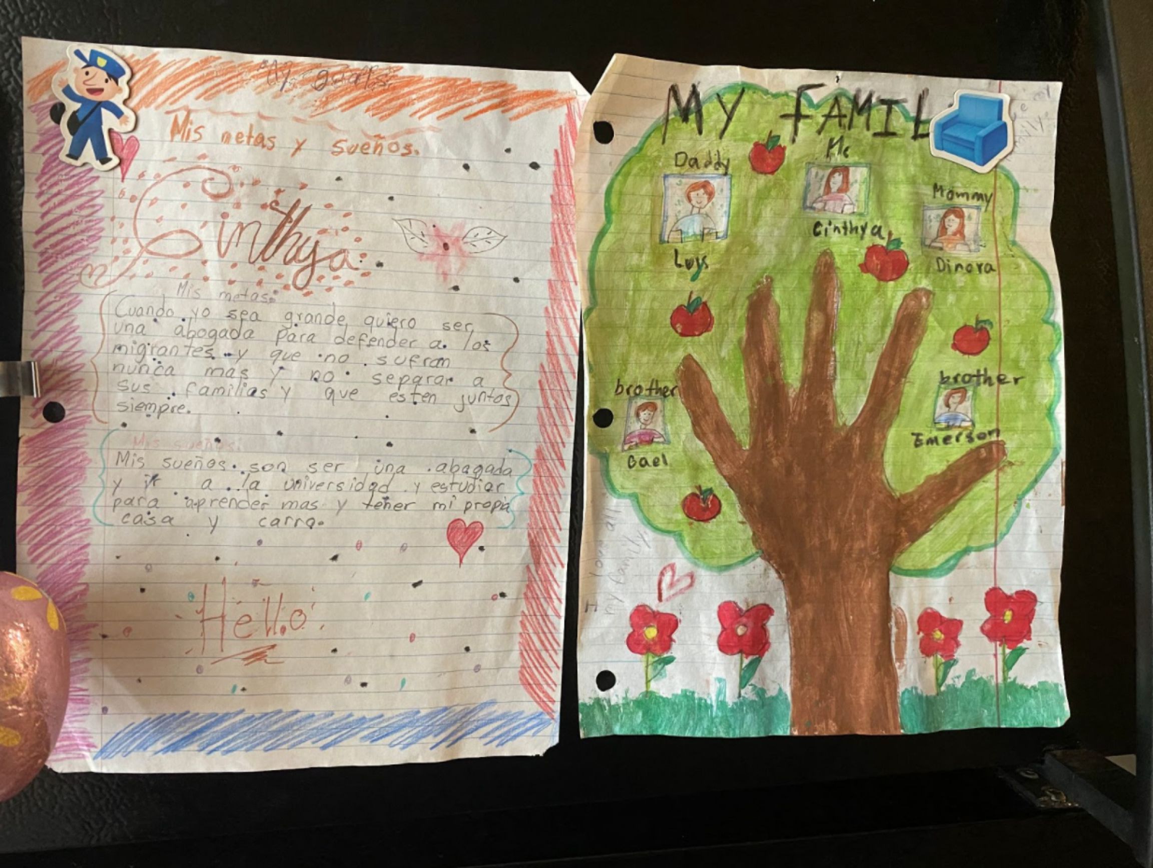Drawings and writing by Cinthya Hernandez, 11, are posted on her family's refrigerator.