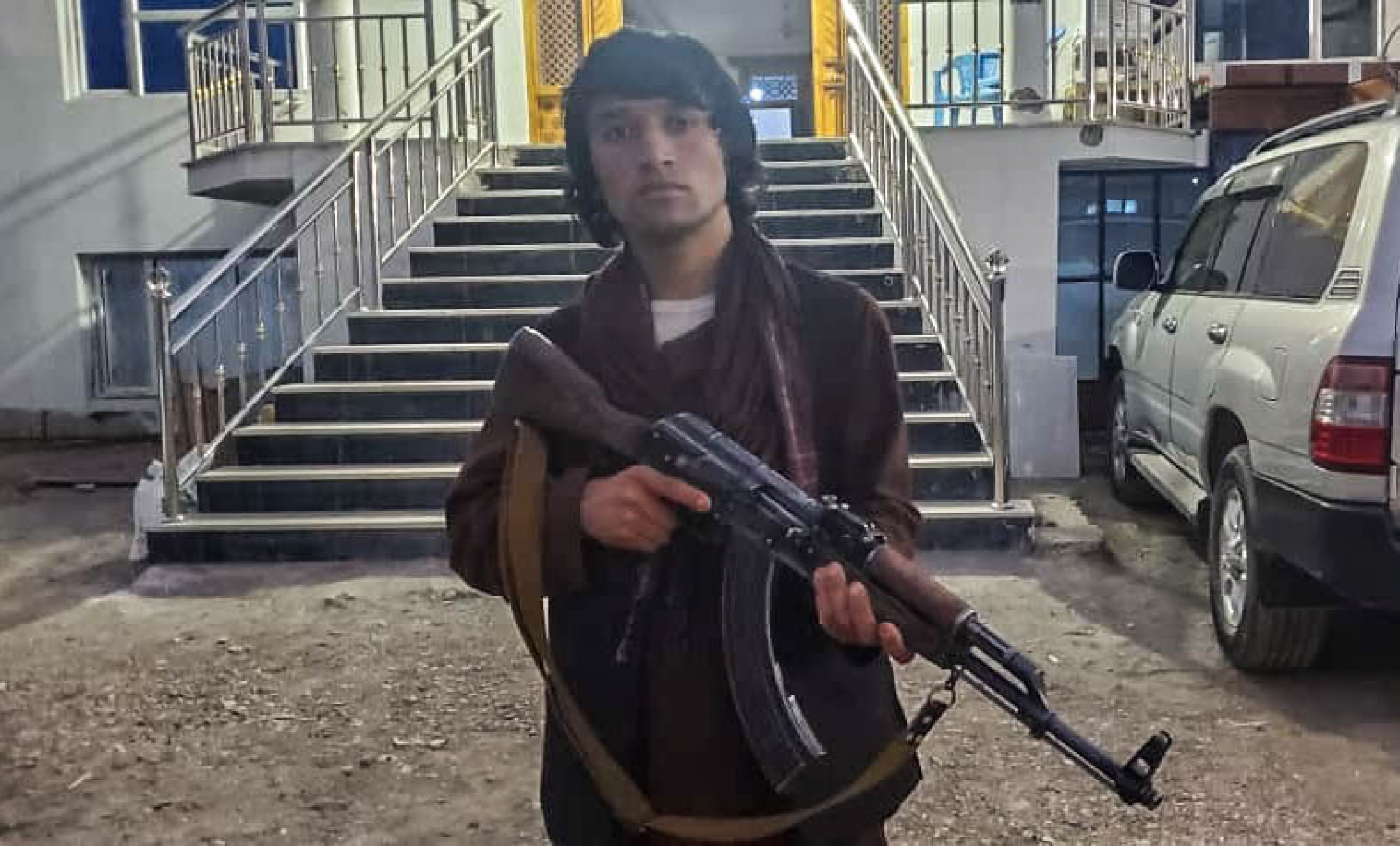 Twenty-year-old Safar Mohammad holds his AK-47 at a popular mobilization headquarter in Baghlan province in northern Afghanistan.