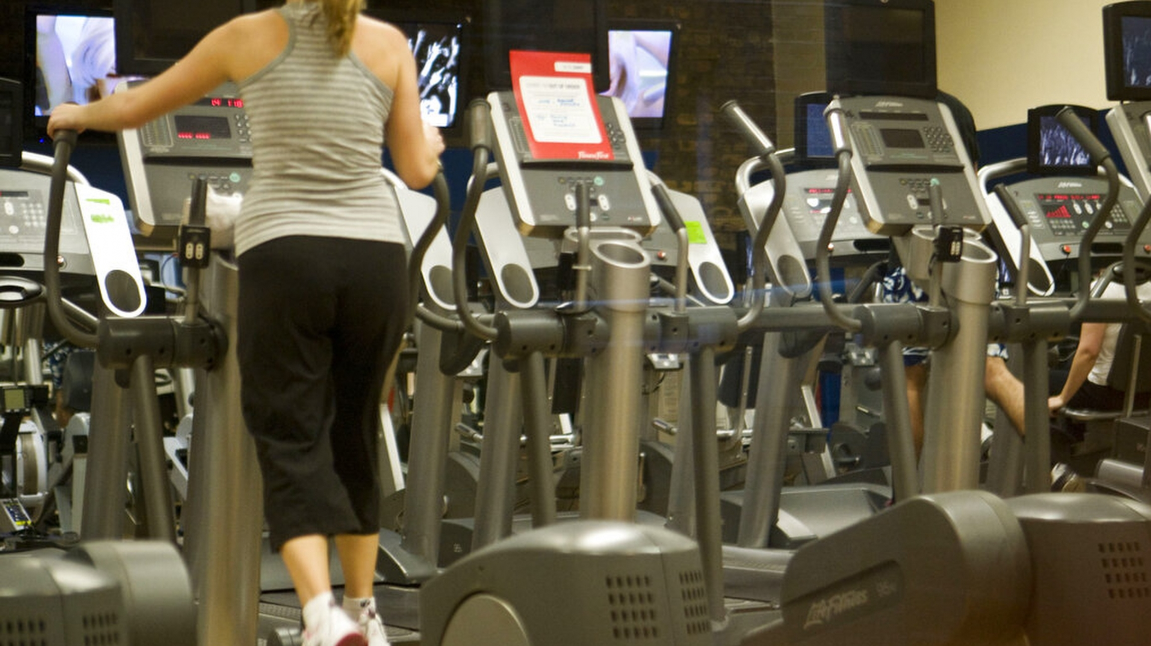 Woman in a gym on an exercise machine