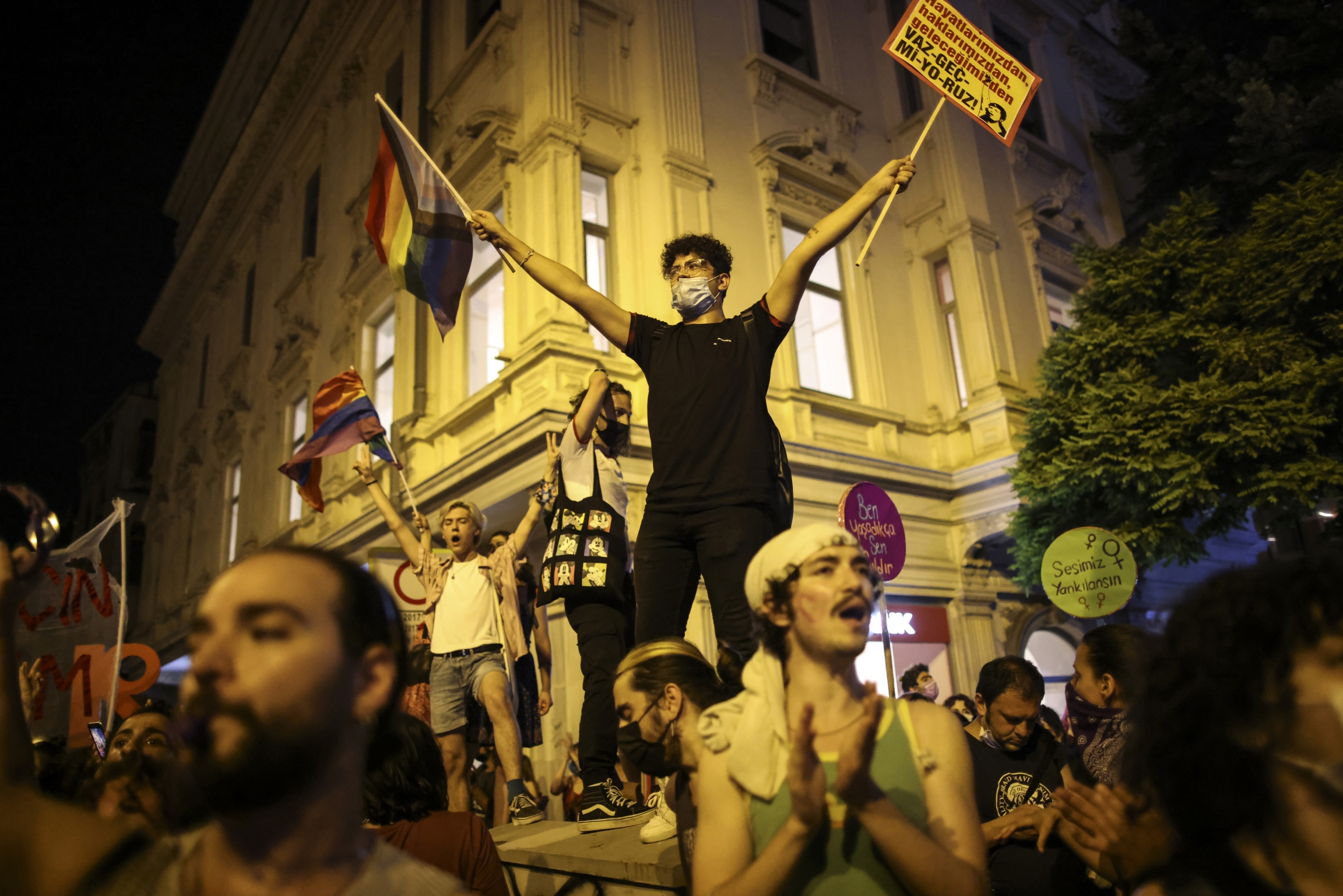 People chant slogans during a protest against the government's decision to withdraw from Istanbul Convention, in Istanbul, Thursday, July 1, 2021.