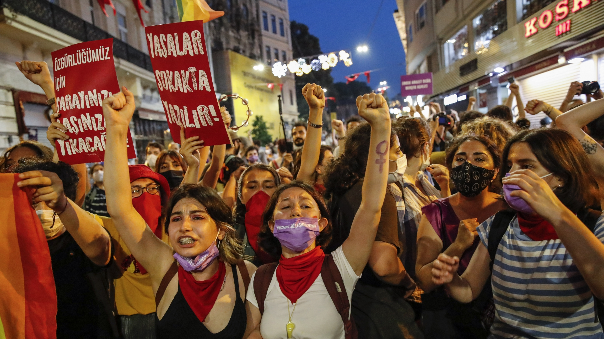 Protesters chant slogans against the government's decision to withdraw from Istanbul Convention