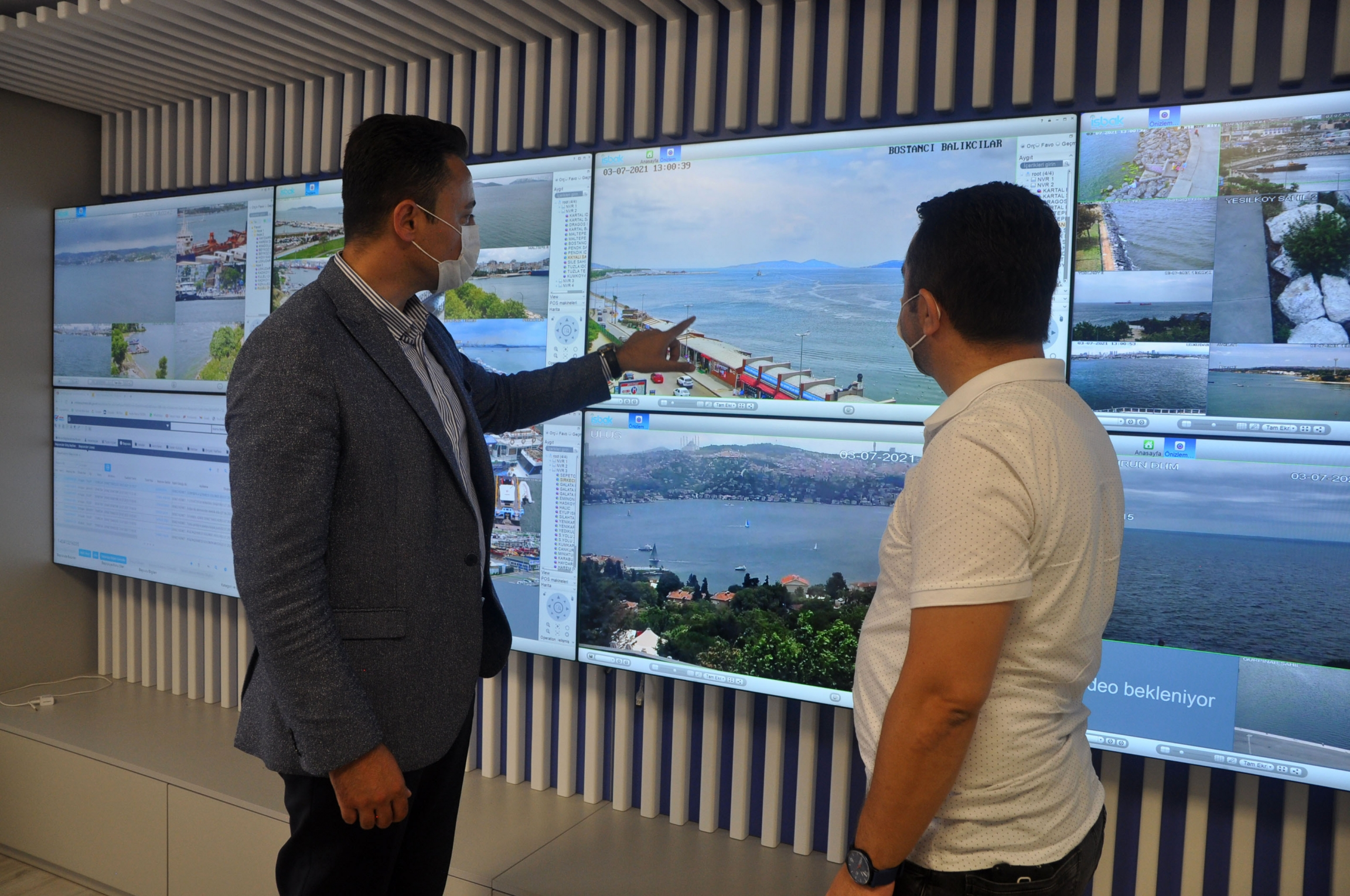 İlker Aslan (left) and Fatih Polat Timur identify a patch of sea snot near the district of Kadiköy, off Istanbul's beach. The setup of monitors was designed by Timur to monitor litter and other pollutants emitted by ship traffic. Tips are radioed into the