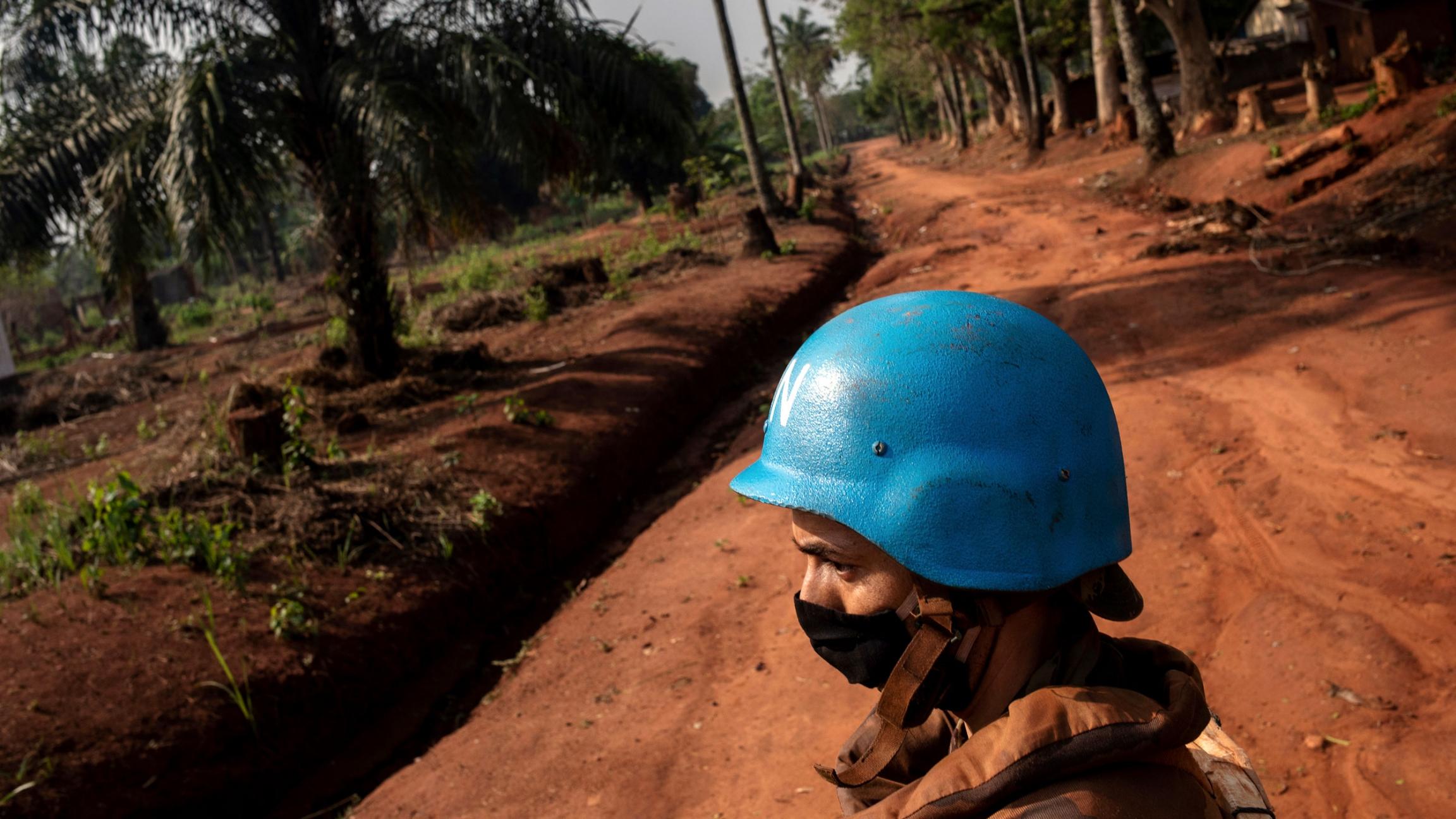 Moroccan UN peacekeepers wearing blue helmets patrol a rich soil road Bangassou, Central African Republic, Feb. 14, 2021.