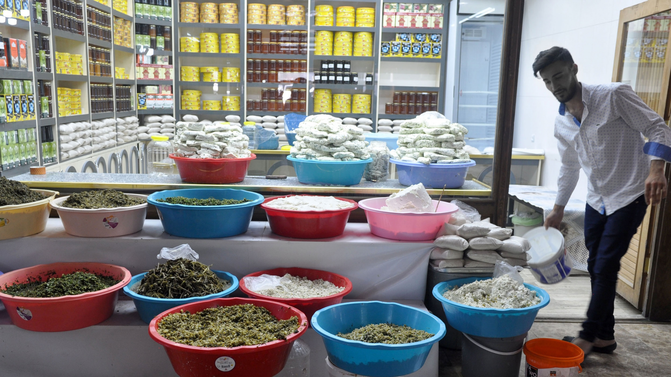A well-stocked shop at Van's historic cheese bazaar, which includes an array of pickled wild herbs, sold separately.
