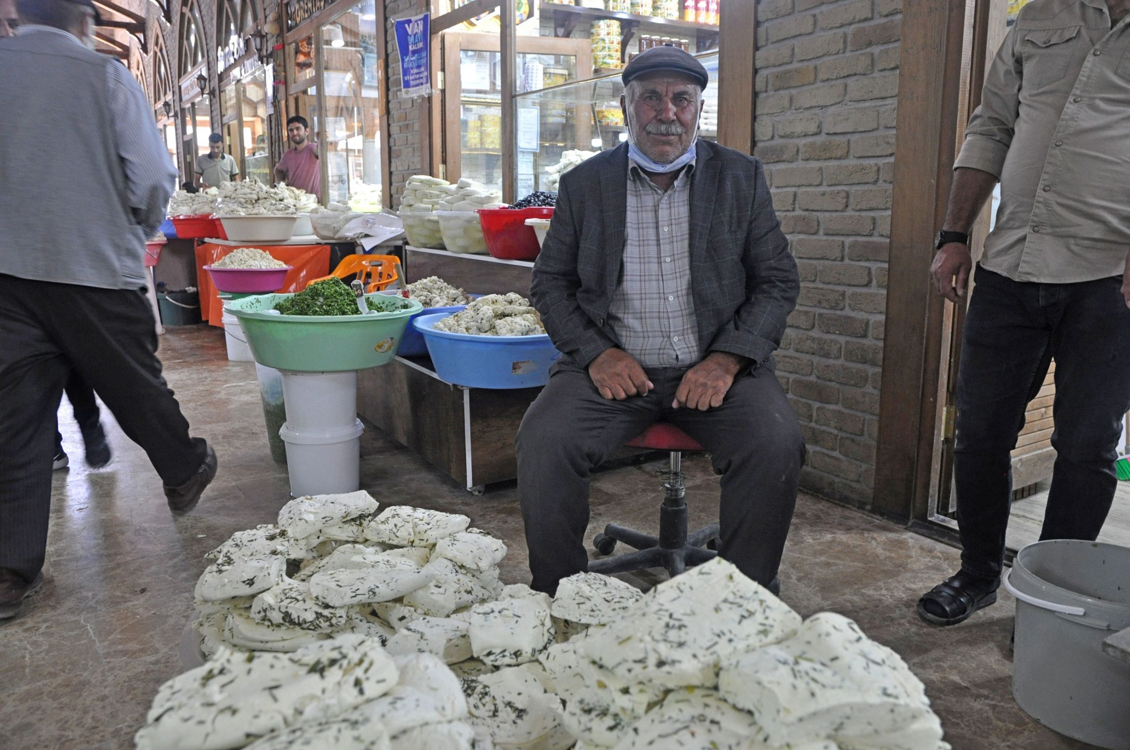 A cheese producer who gave just his first name, Islam, sits with 150 kilograms of Van Otlu Peyniri.
