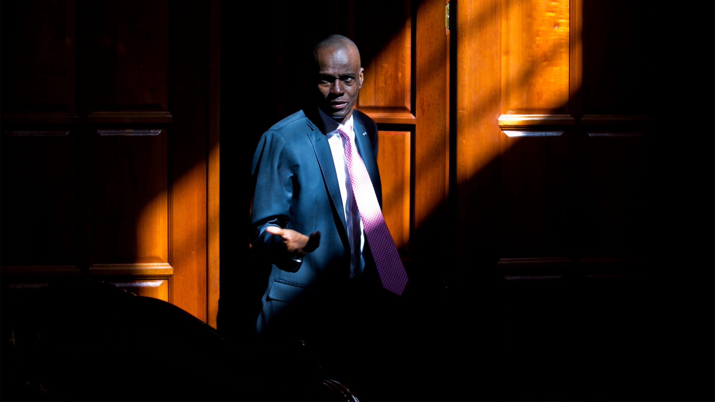 Haitian President Jovenel Moise arrives for an interview at his home in Petion-Ville, a suburb of Port-au-Prince, Haiti