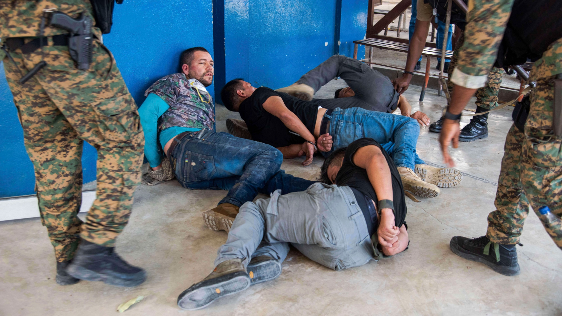 Suspects in the assassination of Haiti's President Jovenel Moïse are tossed on the floor after being detained.