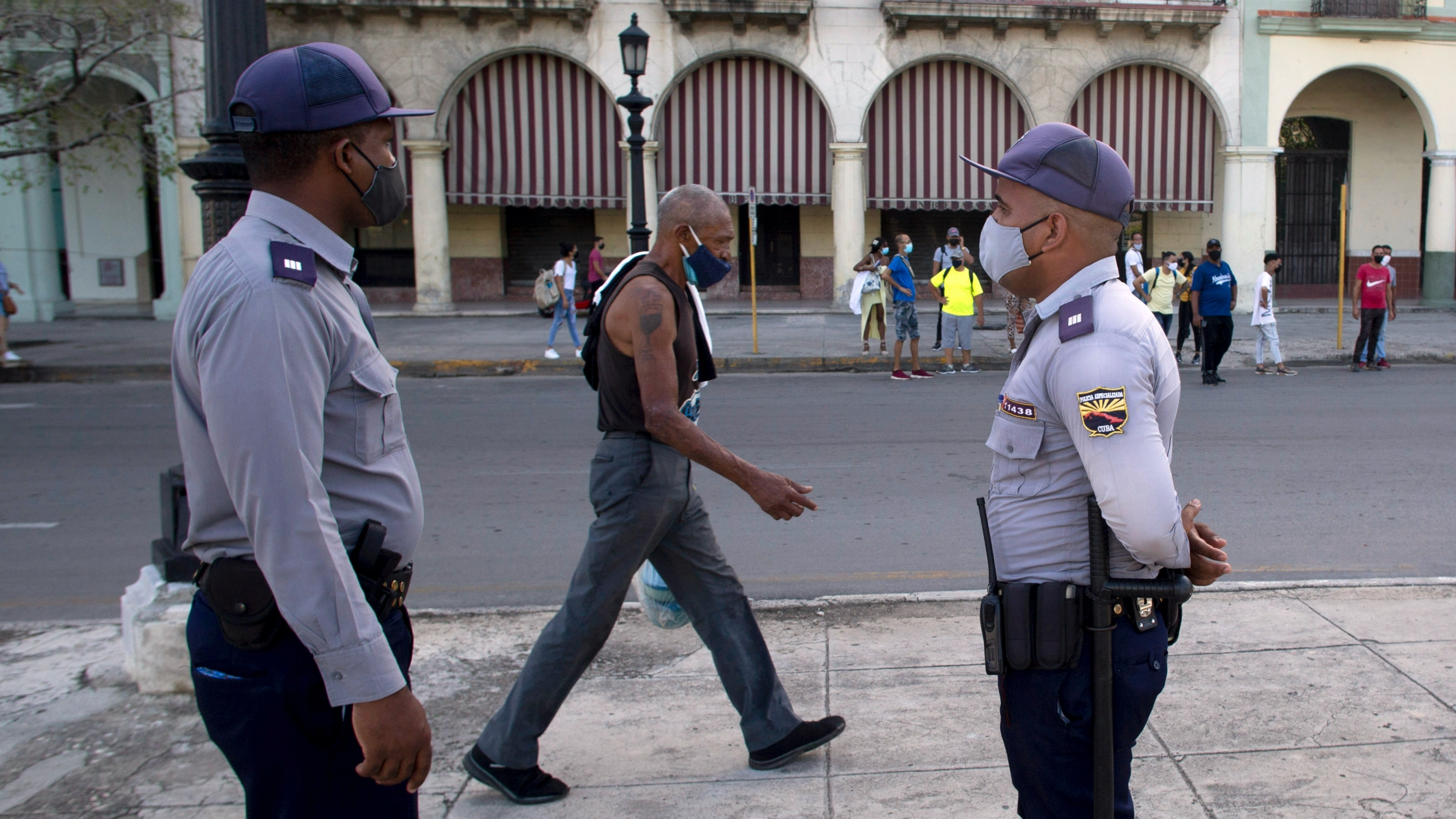 Police stand guard near the National Capitol building in Havana, Cuba, July 12, 2021, the day after protests against food shortages and high prices amid the coronavirus crisis.