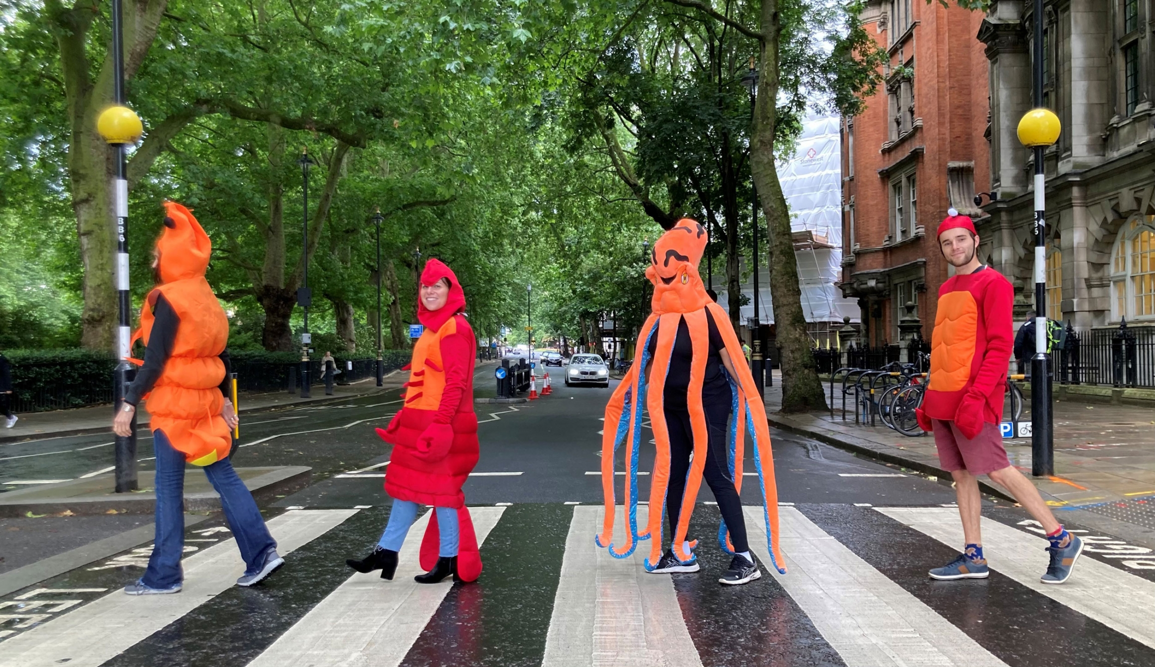 Activists with Crustacean Compassion wear shellfish costumes as they cross the street.