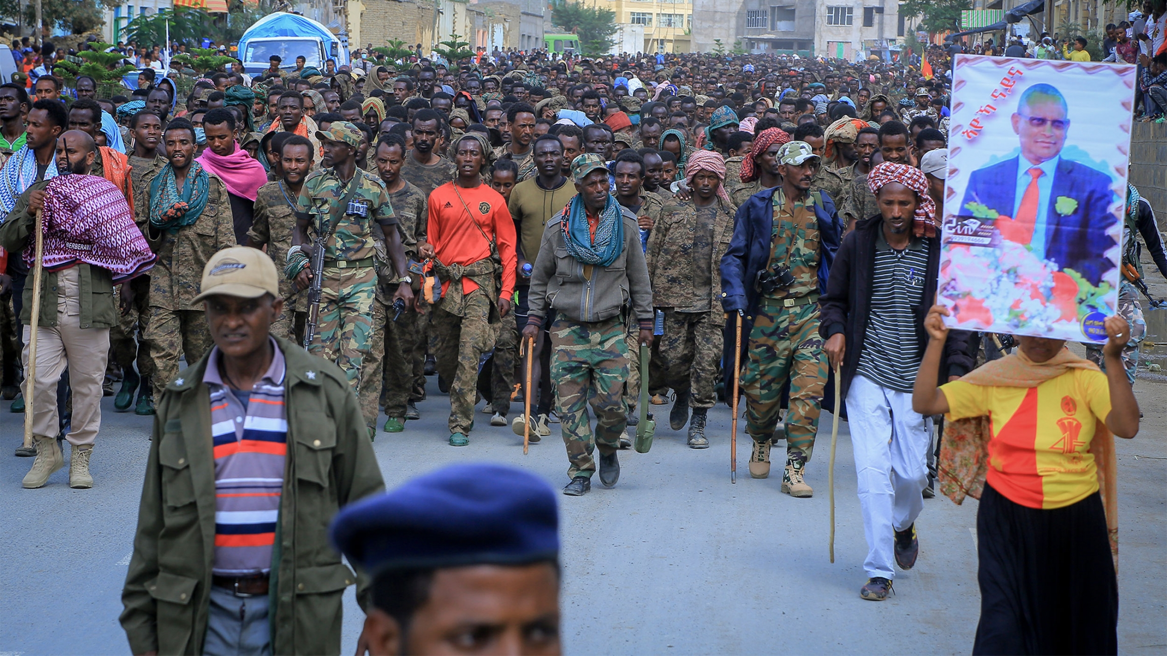 Captured members of the Ethiopian National Defense Force are marched through the streets to prison under guard by Tigray Forces