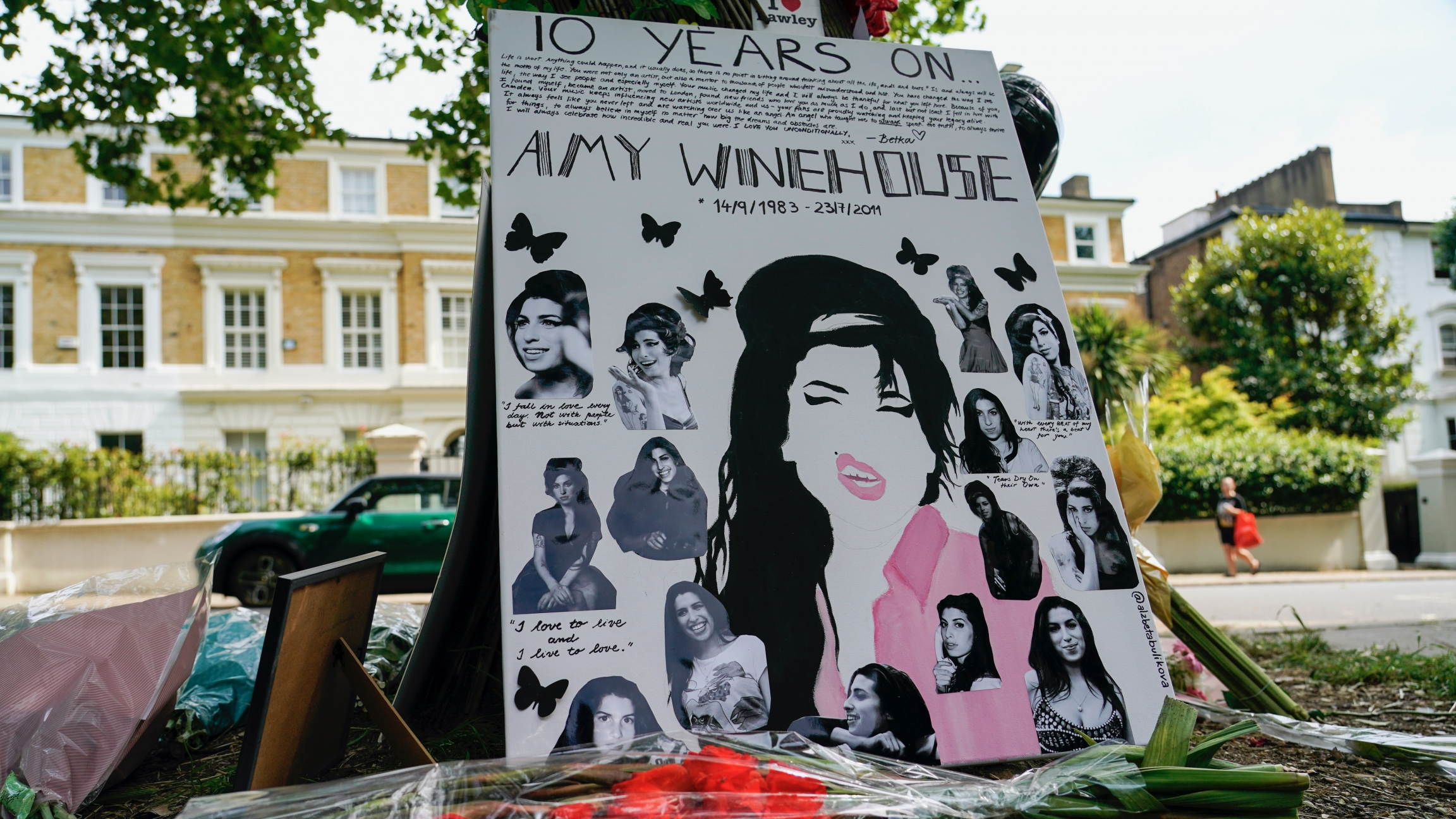 Tributes left outside the former home of Amy Winehouse in Camden, London, Friday, July 23, 2021, on the 10th anniversary of the iconic British singer's death from accidental alcohol poisoning.