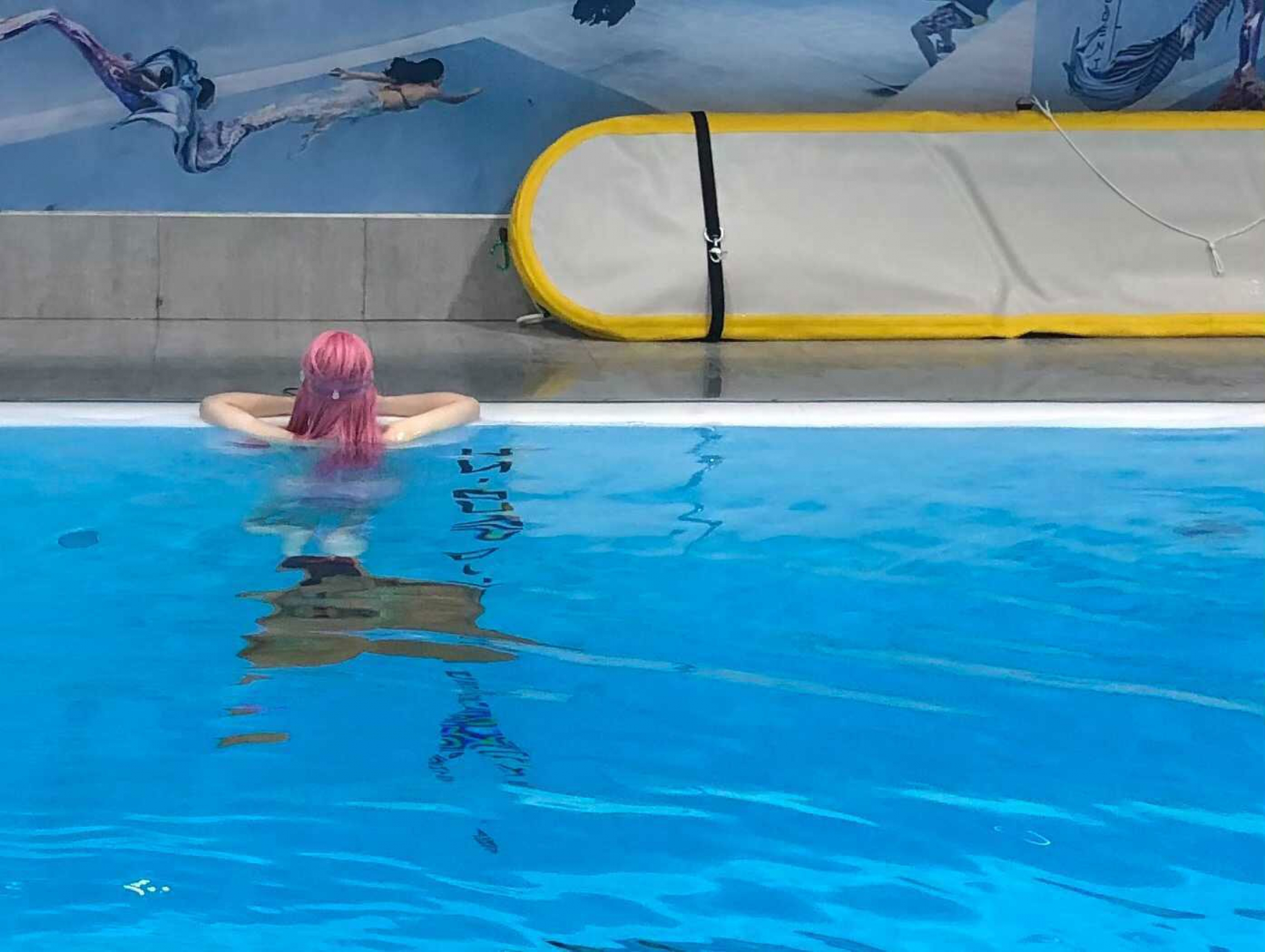 Chen Menke taking a rest from training to be a mermaid instructor.