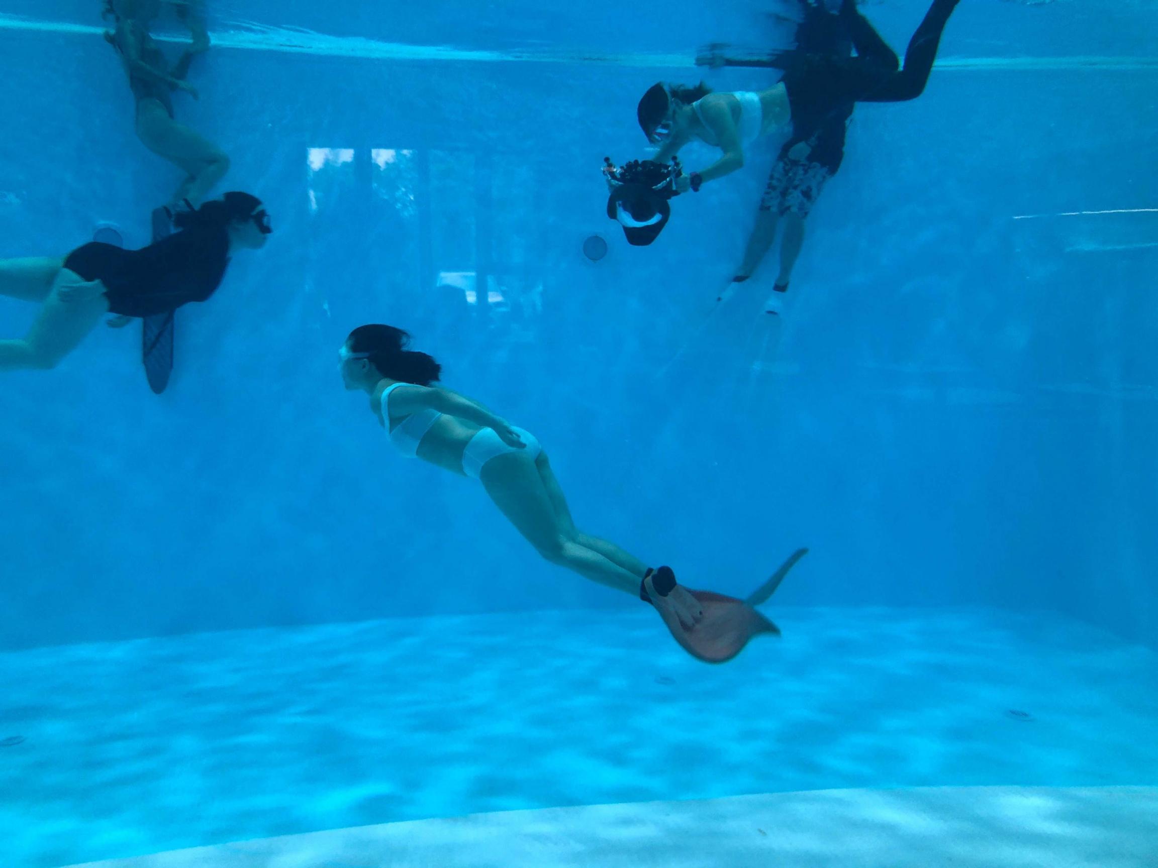 Instructor Rachel Wang takes photos of student Christina Bao under water.