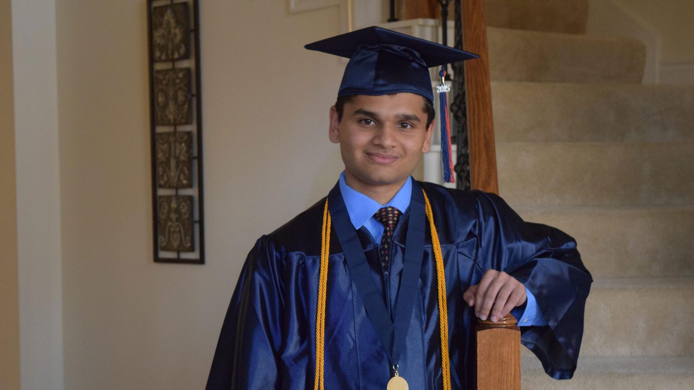 Animesh Namjoshi poses for a graduation photo after receiving his diploma at Seven Lakes High School
