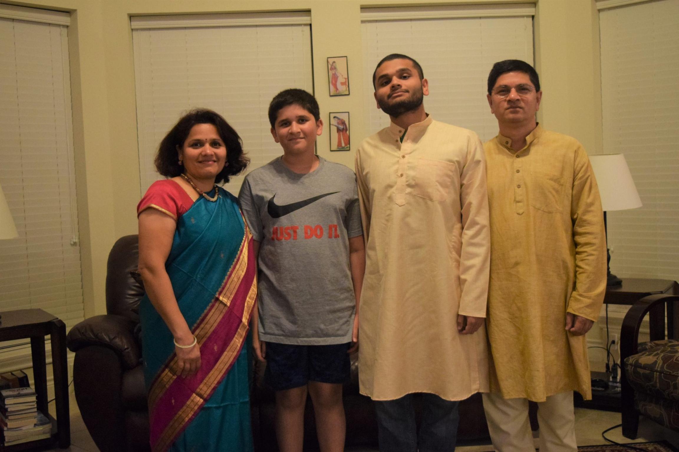 Animesh Namjoshi, center right, celebrates Diwali with his father, Jayant, mother, Sarita, and brother Aditya.