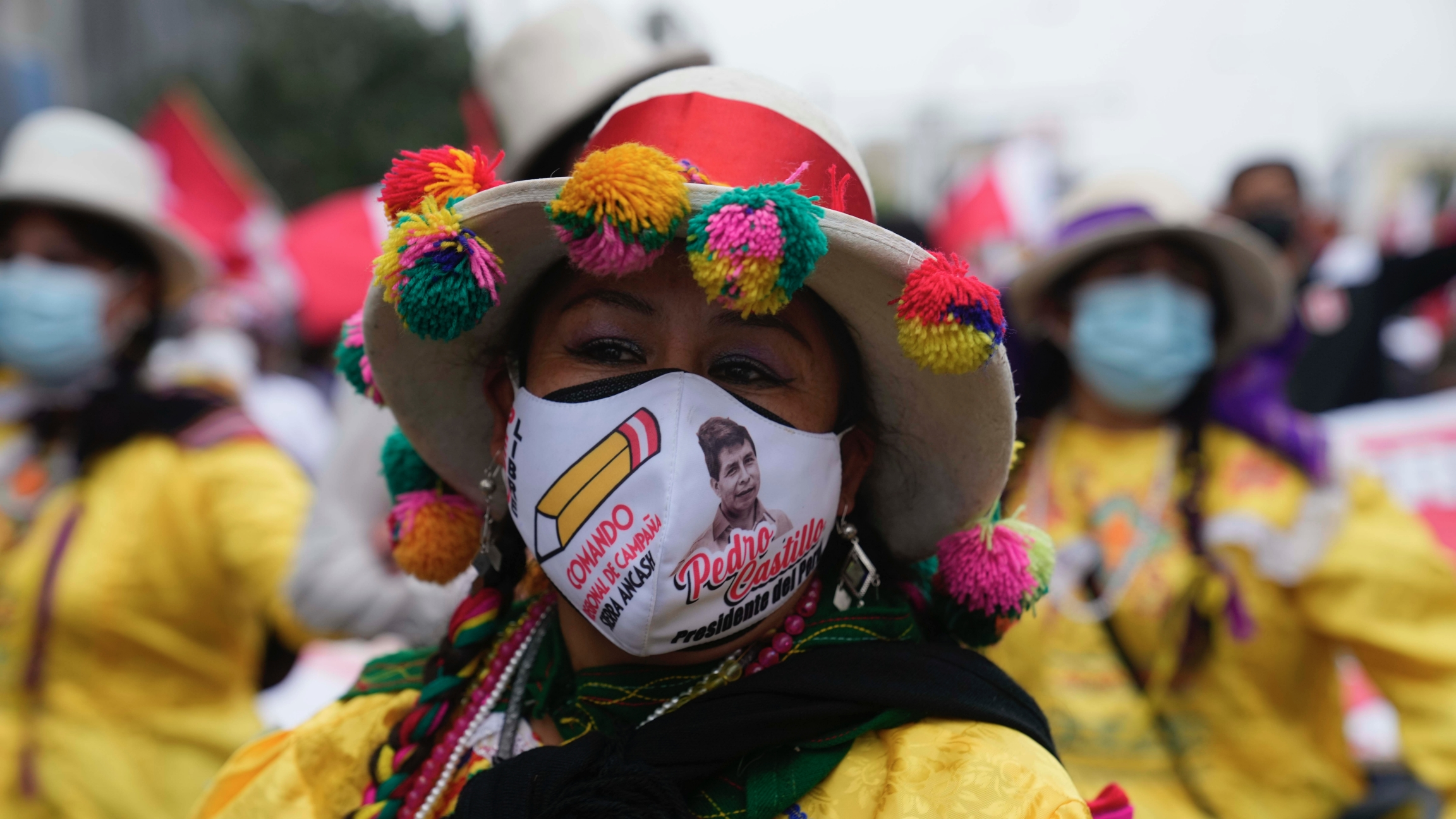 People march in support of presidential candidate Pedro Castillo weeks after the presidential runoff election, in Lima, Peru, June 26, 2021. With all the votes tallied from the June 6th presidential runoff, Castillo is ahead of his rival candidate Keiko F