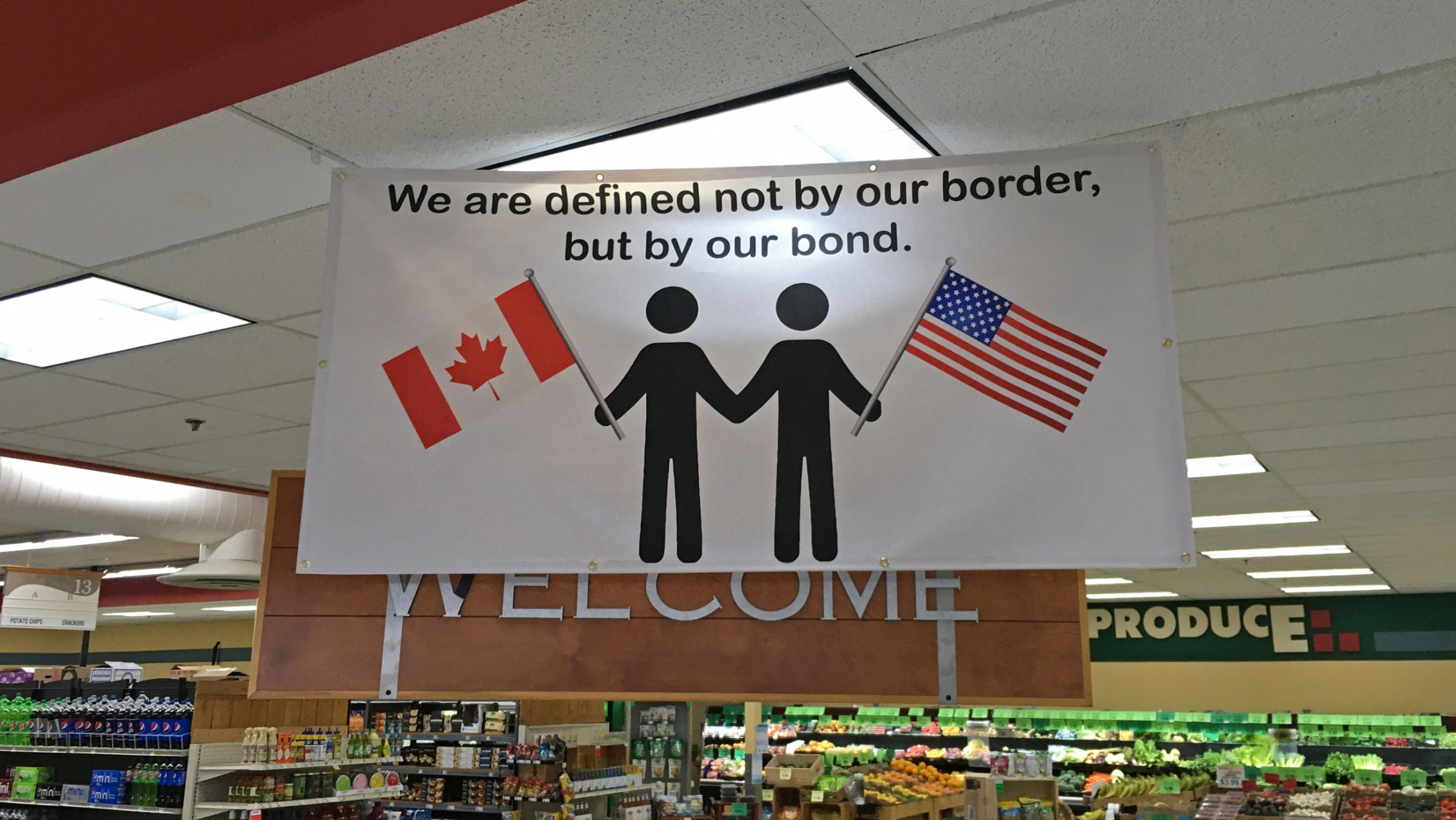 Several businesses in Point Roberts display this sign of solidarity, seen here inside Point Roberts International Marketplace.