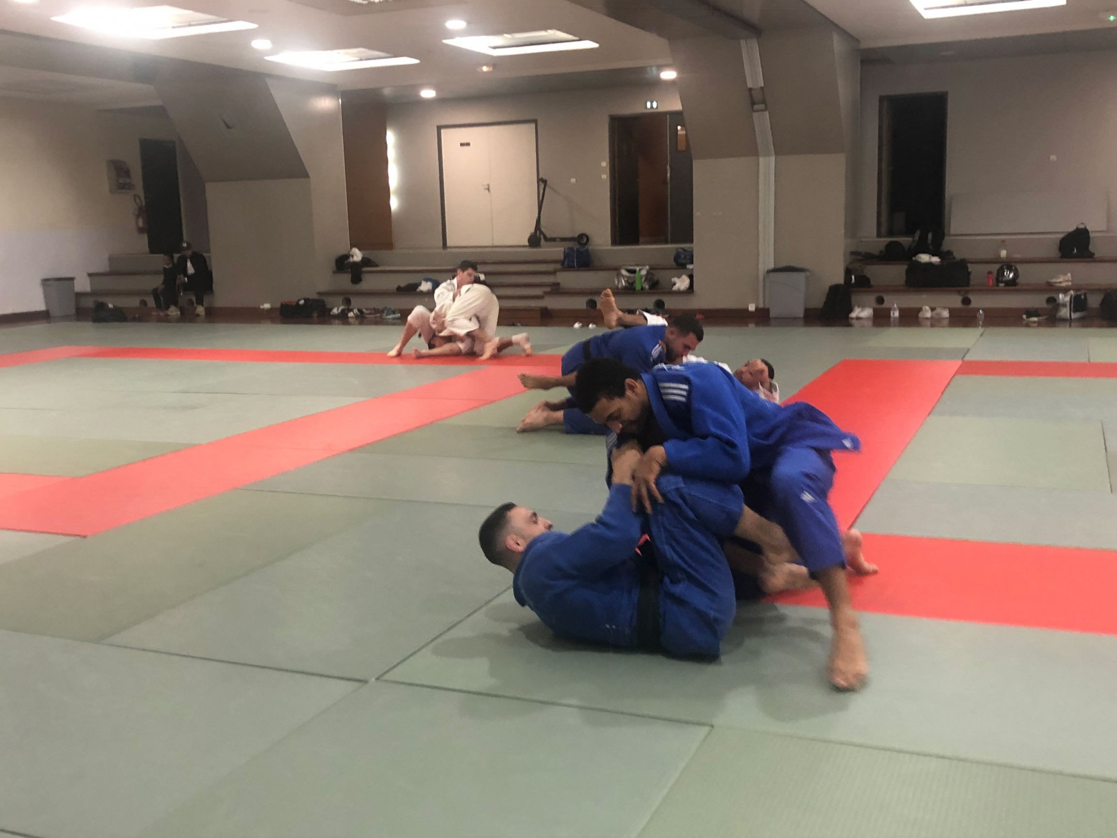 A judo training center on the southern edge of Paris is packed, even though it's the start of the summer holiday season.