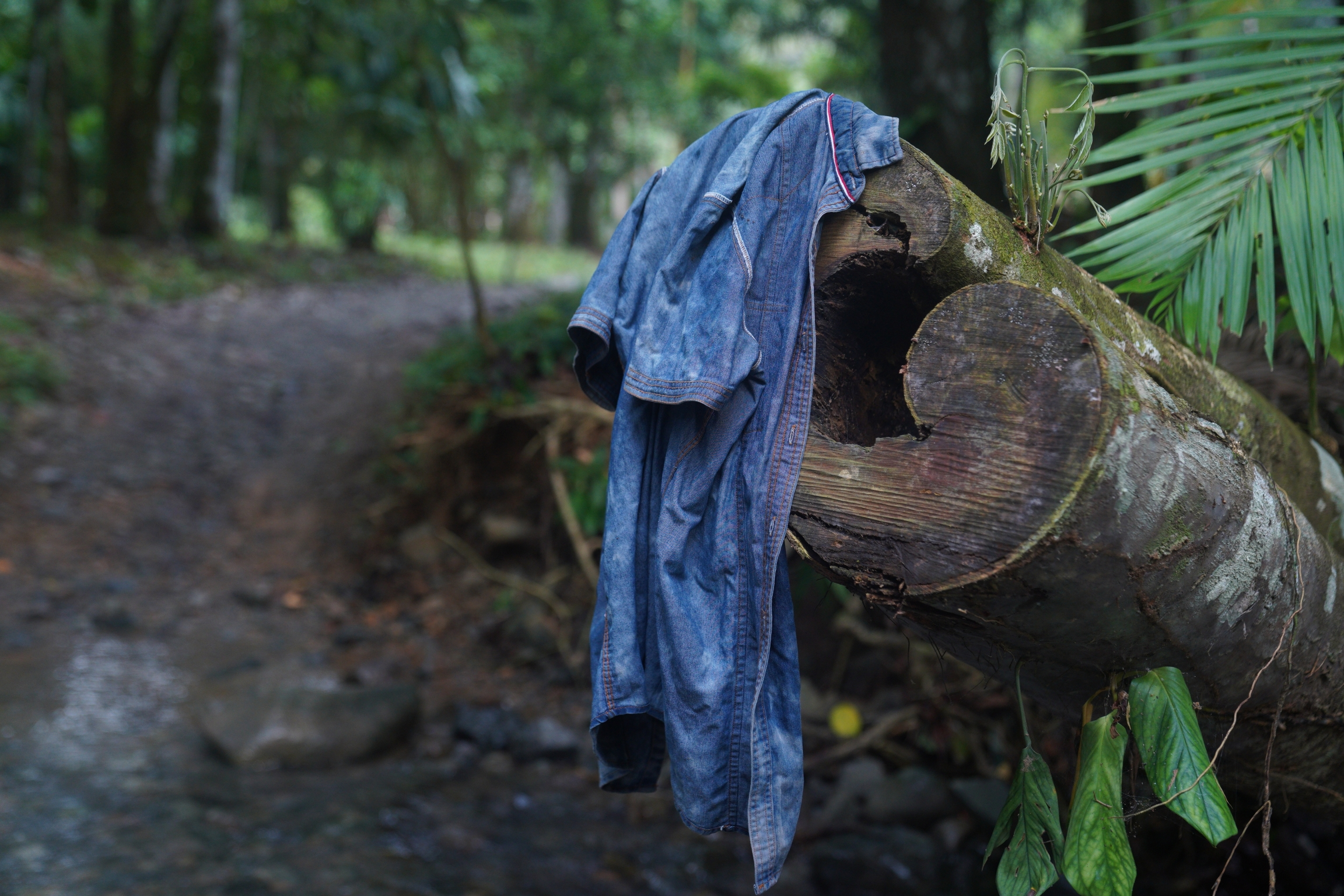 Migrants start to shed some of their belongings as they begin to trek through the Darien Gap
