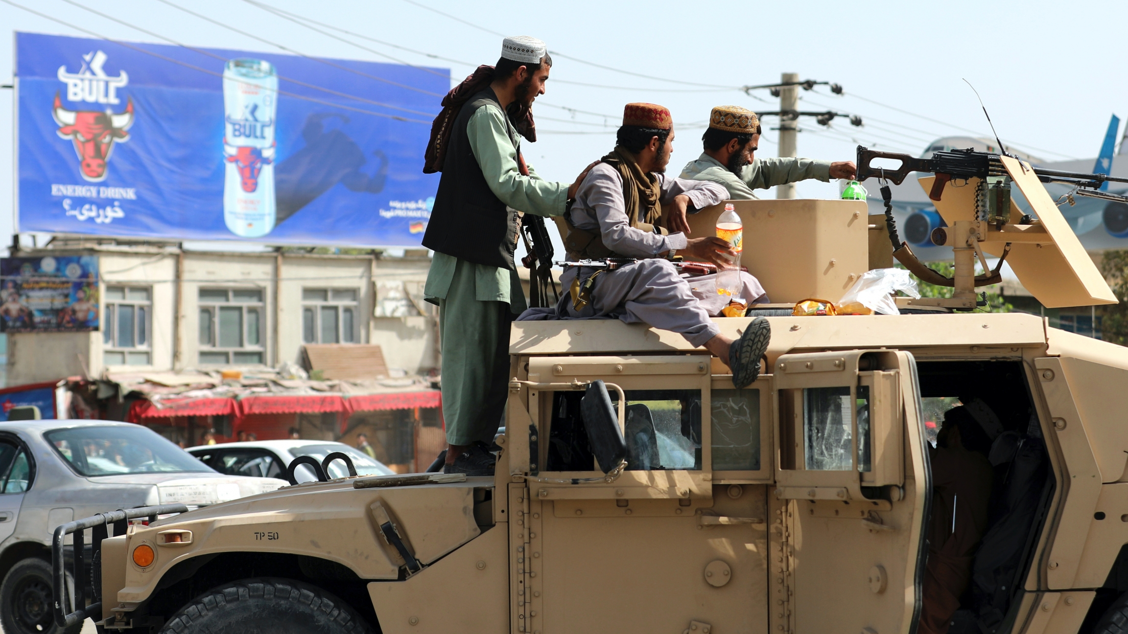 Taliban fighters stand guard in front of the Hamid Karzai International Airport, in Kabul, Afghanistan,Aug. 16, 2021.