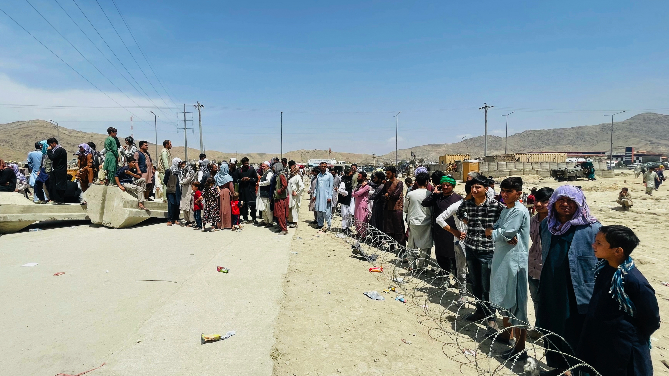 Hundreds of people gather outside the international airport in Kabul, Afghanistan, Aug. 17, 2021.