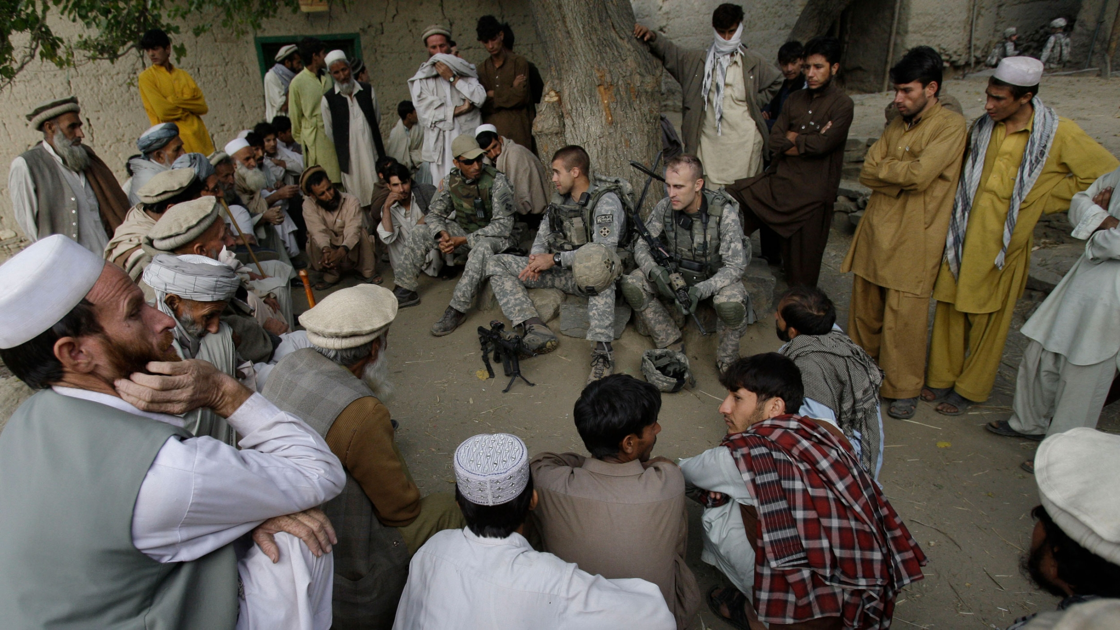 Lt. Thomas Goodman meets with villagers in Qatar Kala in the Pech Valley of Afghanistan's Kunar province with his interpreter Ayazudin Hilal.