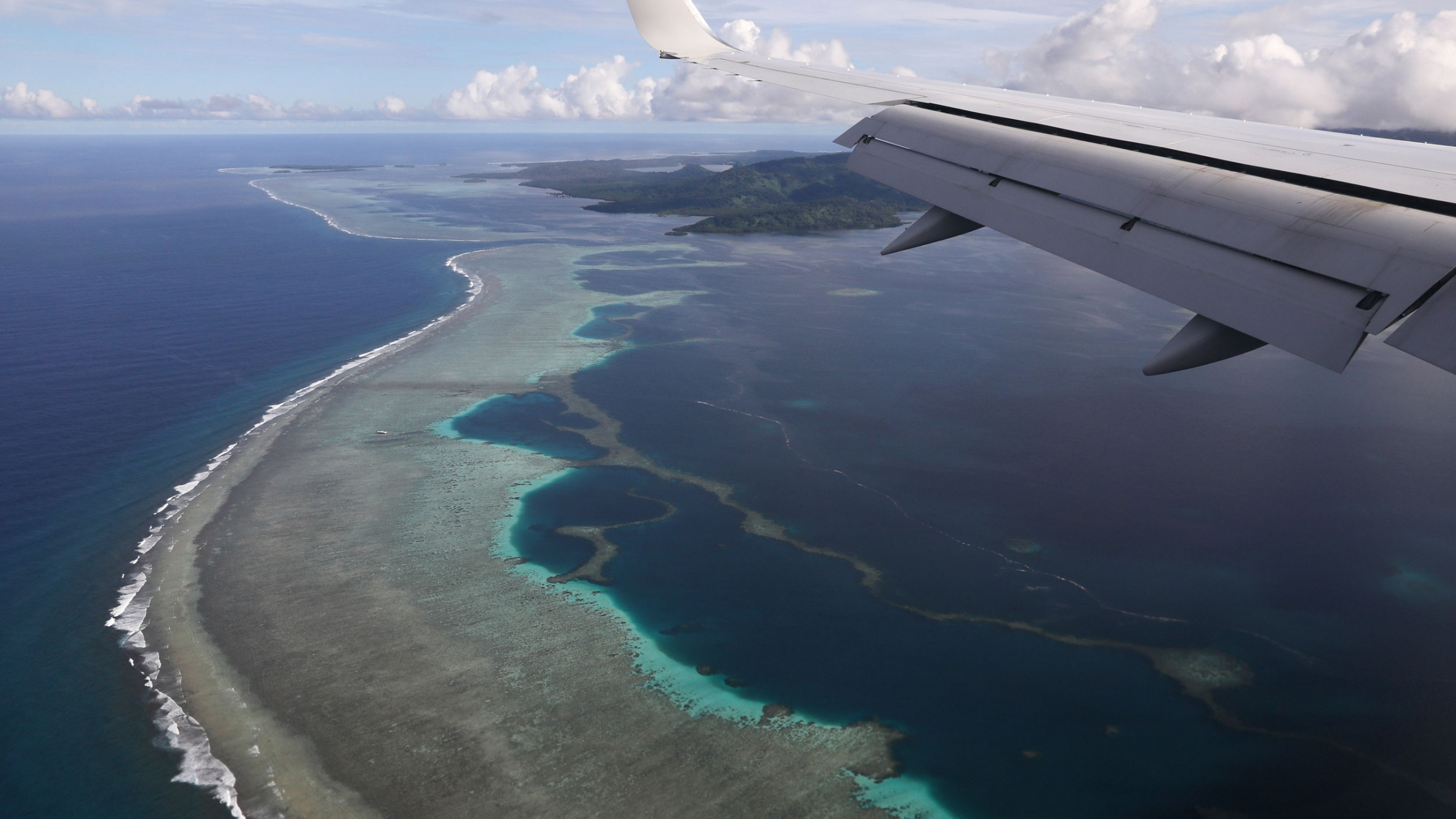 Former US Secretary of State Mike Pompeo's plane makes its landing approach on Pohnpei International Airport in Kolonia, Federated States of Micronesia, Monday, Aug. 5, 2019.