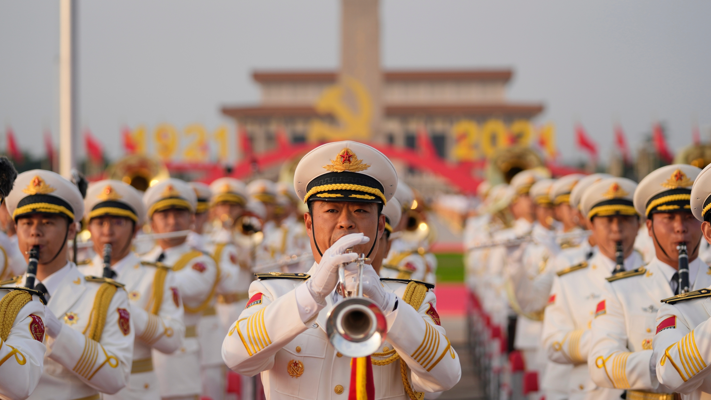 A military band rehearses for a ceremony to mark the 100th anniversary of the founding of the ruling Chinese Communist Party at Tiananmen Gate in Beijing,July 1, 2021. Chinese fighter jets, anti-submarine aircraft and combat ships conducted assault drill