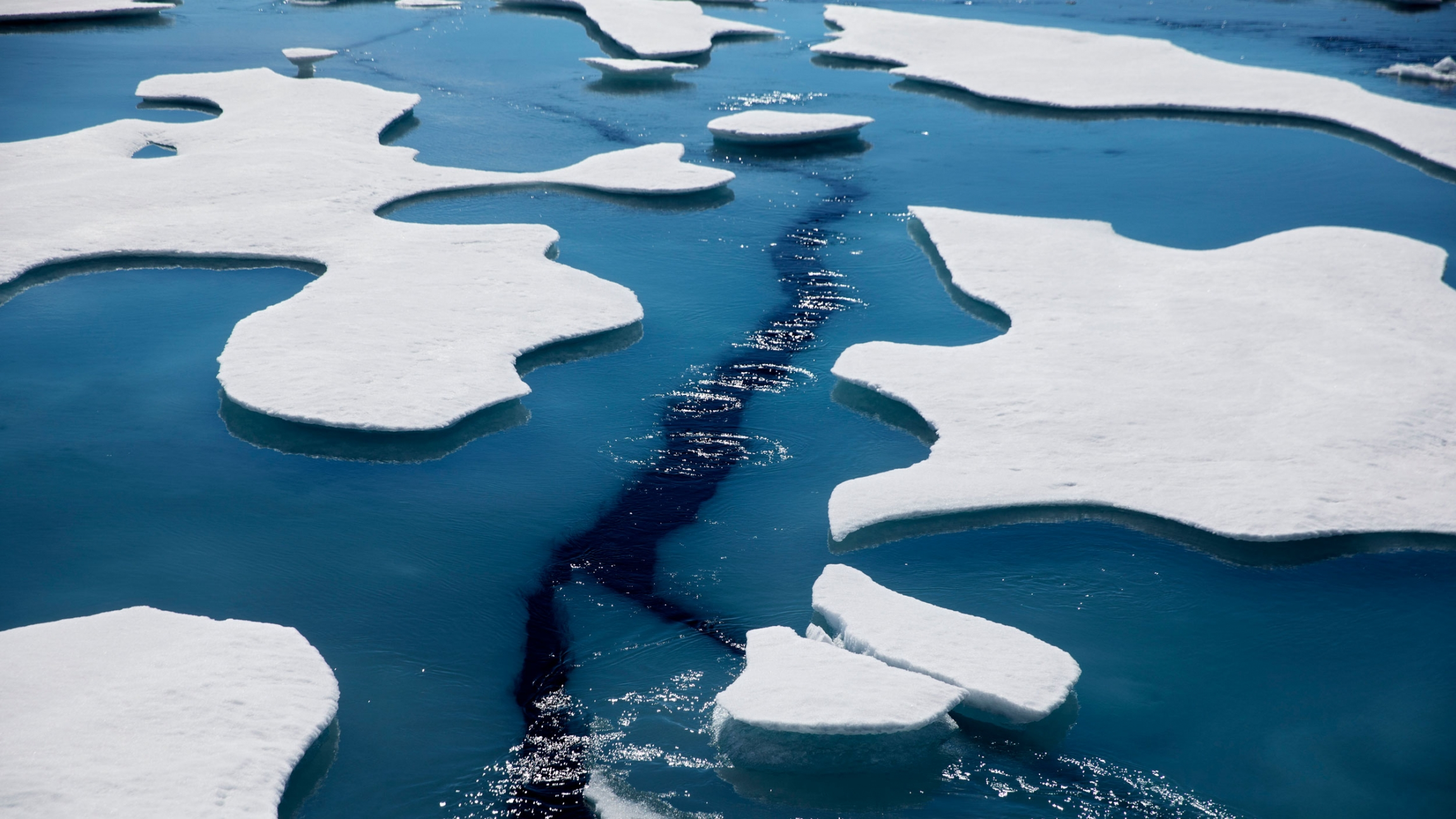 Sea ice breaks apart as the Finnish icebreaker MSV Nordica traverses the Northwest Passage through the Victoria Strait in the Canadian Arctic Archipelago in a Friday, July 21, 2017, file photo.