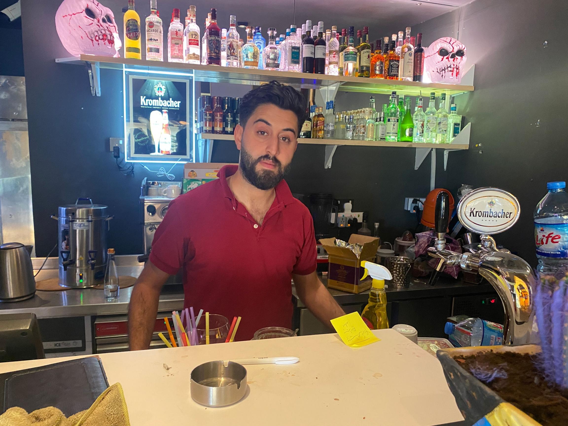 Mabast Zaman is a waiter wearing a red shirt behind a bar at Senorita TexMex restaurant, Erbil, Iraq.