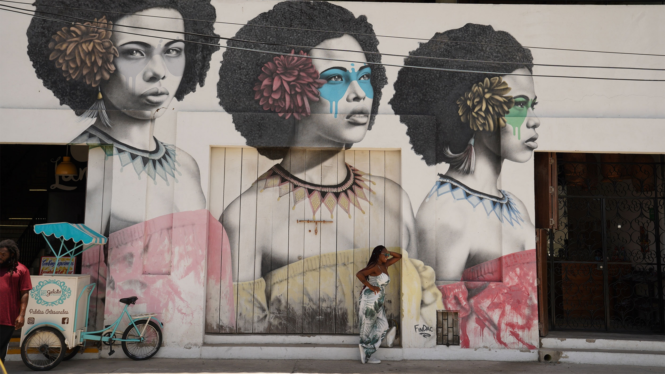 A mural in Cartagena's Getsemani Neighborhood celebrates the city's Afro-Colombian heritage and the natural hairstyles of Black women