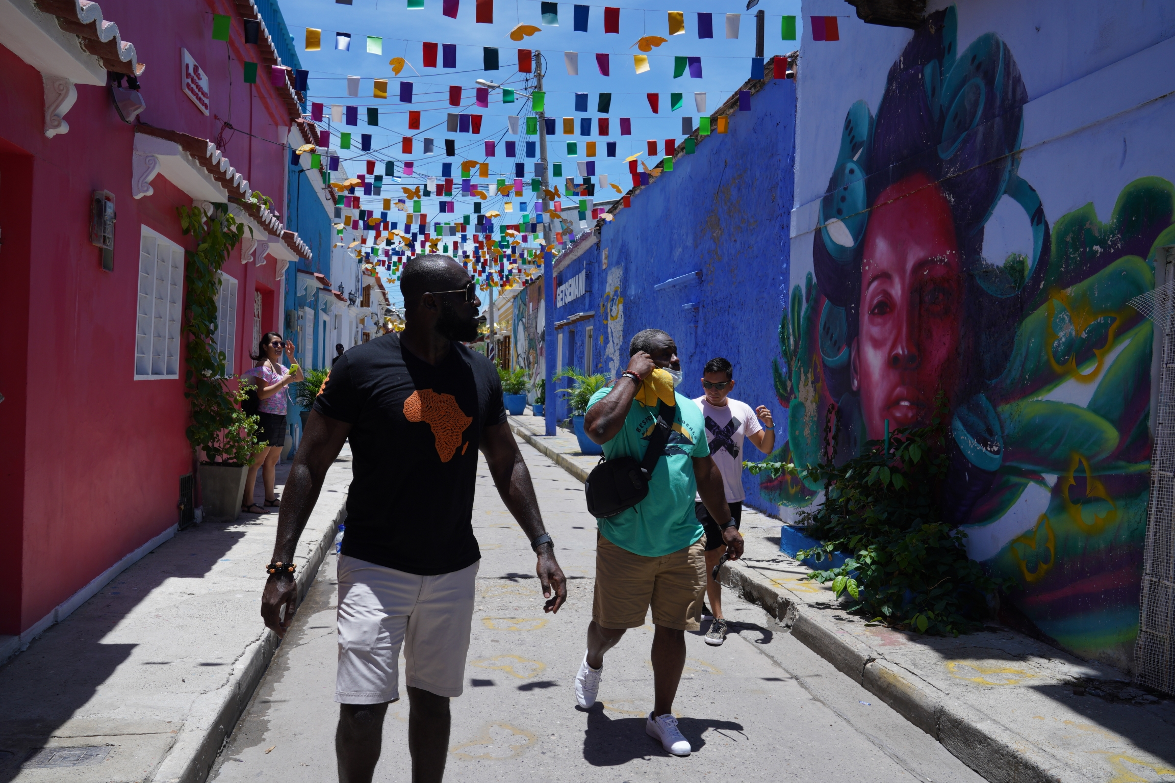 Tourists check out Getsemani. The neighborhood had a reputation from crime until recently, but investors have bought homes there and turned them into restaurants and boutique hotels