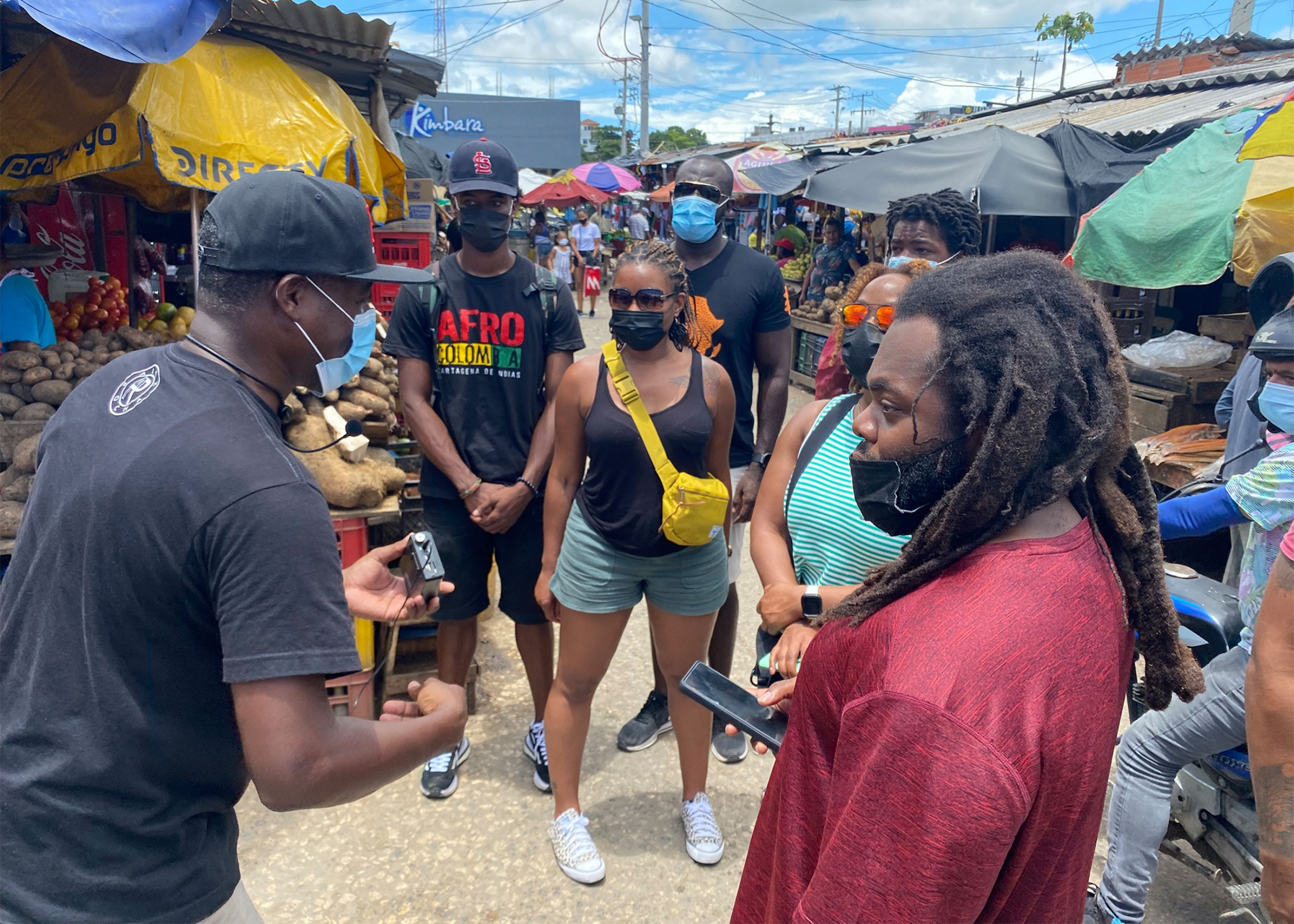 Rocha leads a group of tourists through Cartagena's Bazurto market, where many Afro-Colombians work as street vendors