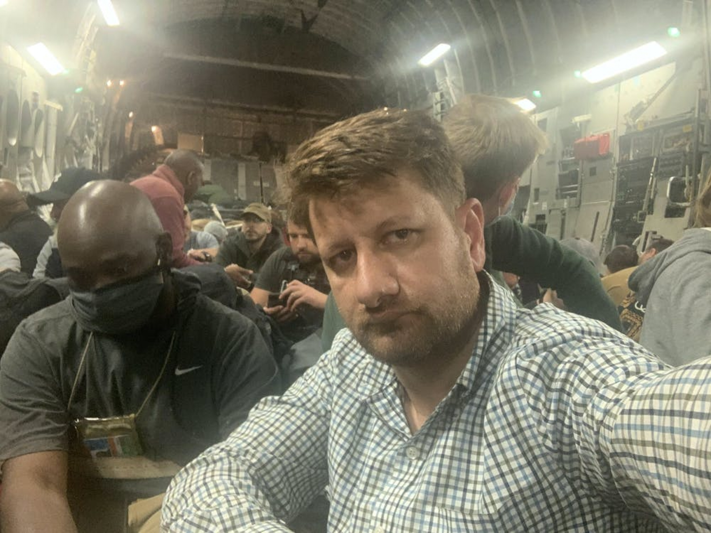 Selfie of Sufizada seated inside a crowded transport
