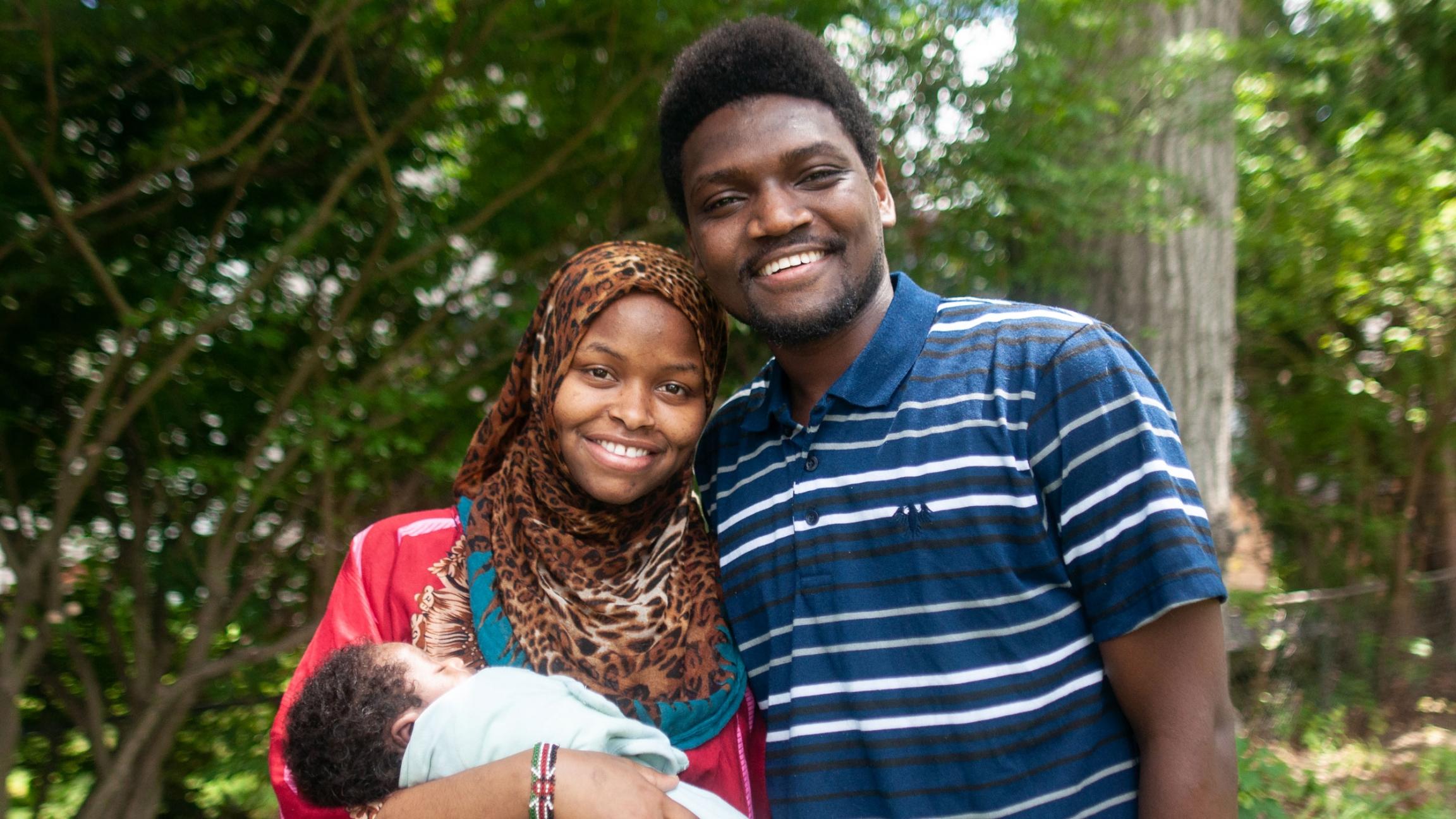 Rumbila Abdullahi and her husband, Ibrahim Abdi, hold their newborn son, Nabeel, outside their home in Springfield, Massachusetts.