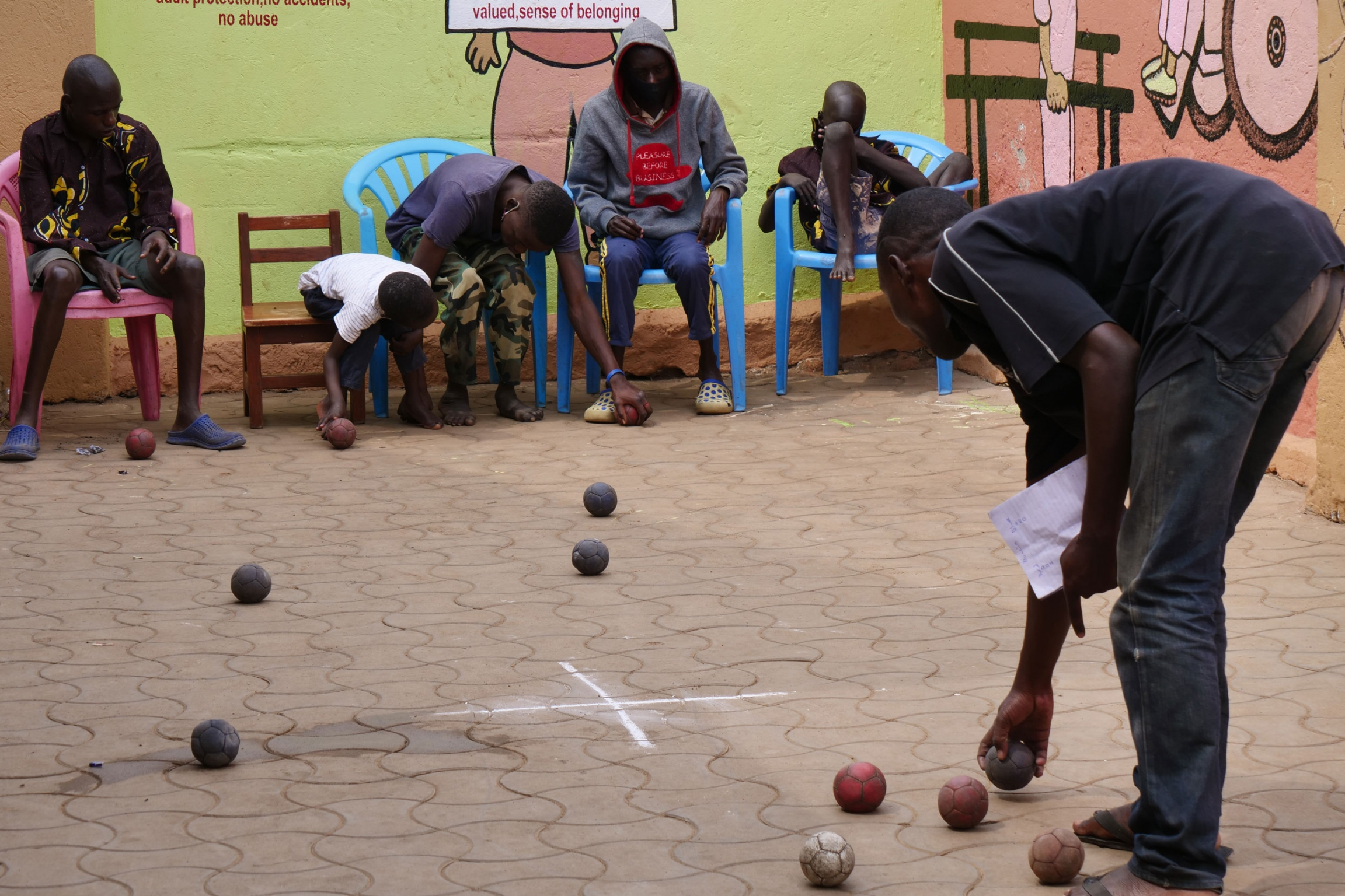 Children and youth with disabilitiesplay bocca at Support Disabled Children Ggaba organization in Kampala, Sept. 1, 2021.