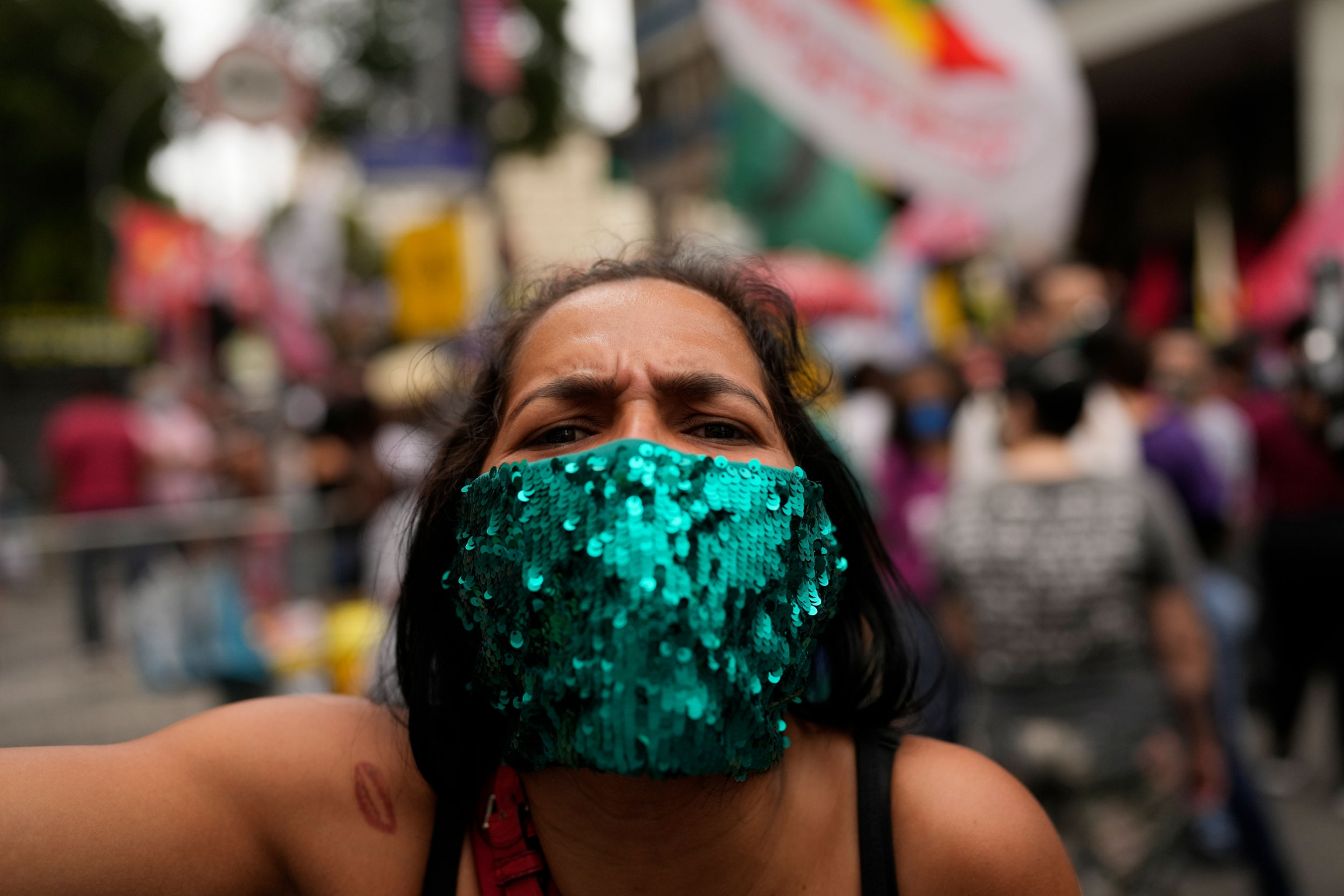 A woman attends a protest against Brazilian President Jair Bolsonaro's handling of the COVID-19 pandemic, the economy and corruption, on Independence Day in Rio de Janeiro, Brazil, Tuesday, Sept. 7, 2021.