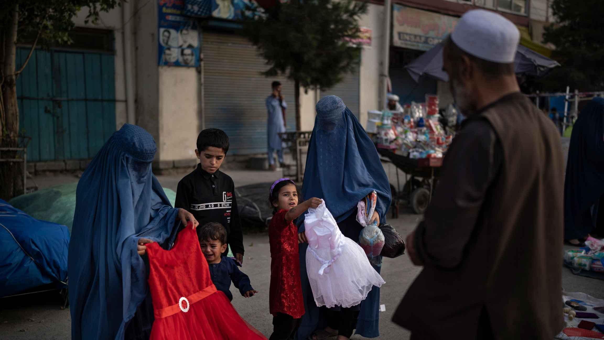 fghan women and a girl shop for dresses at a local market in Kabul, Afghanistan, Friday, Sept. 10, 2021.