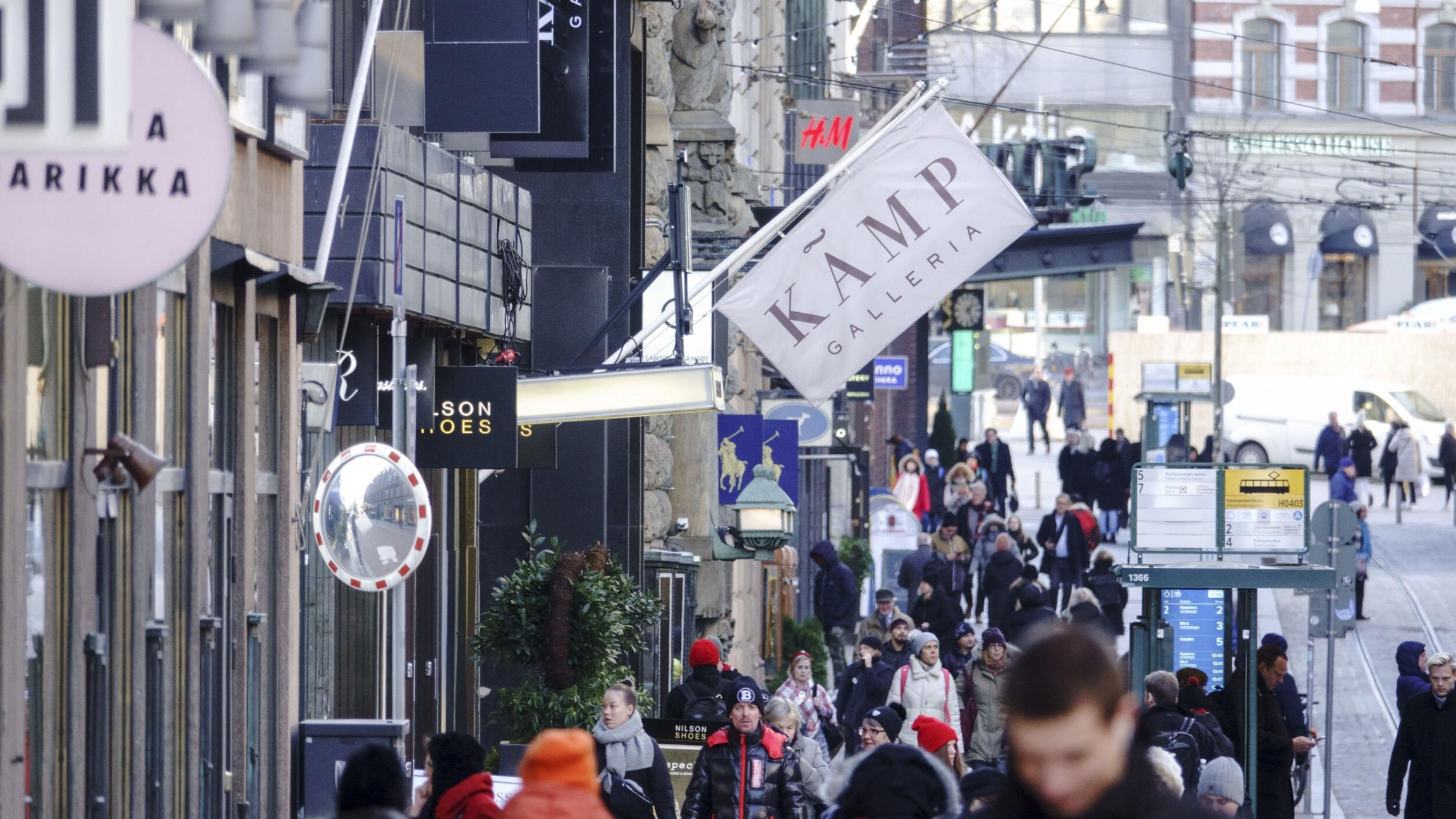 Pedestrians walk along Aleksanterinkatu, the main shopping street, in Helsinki, Finland.