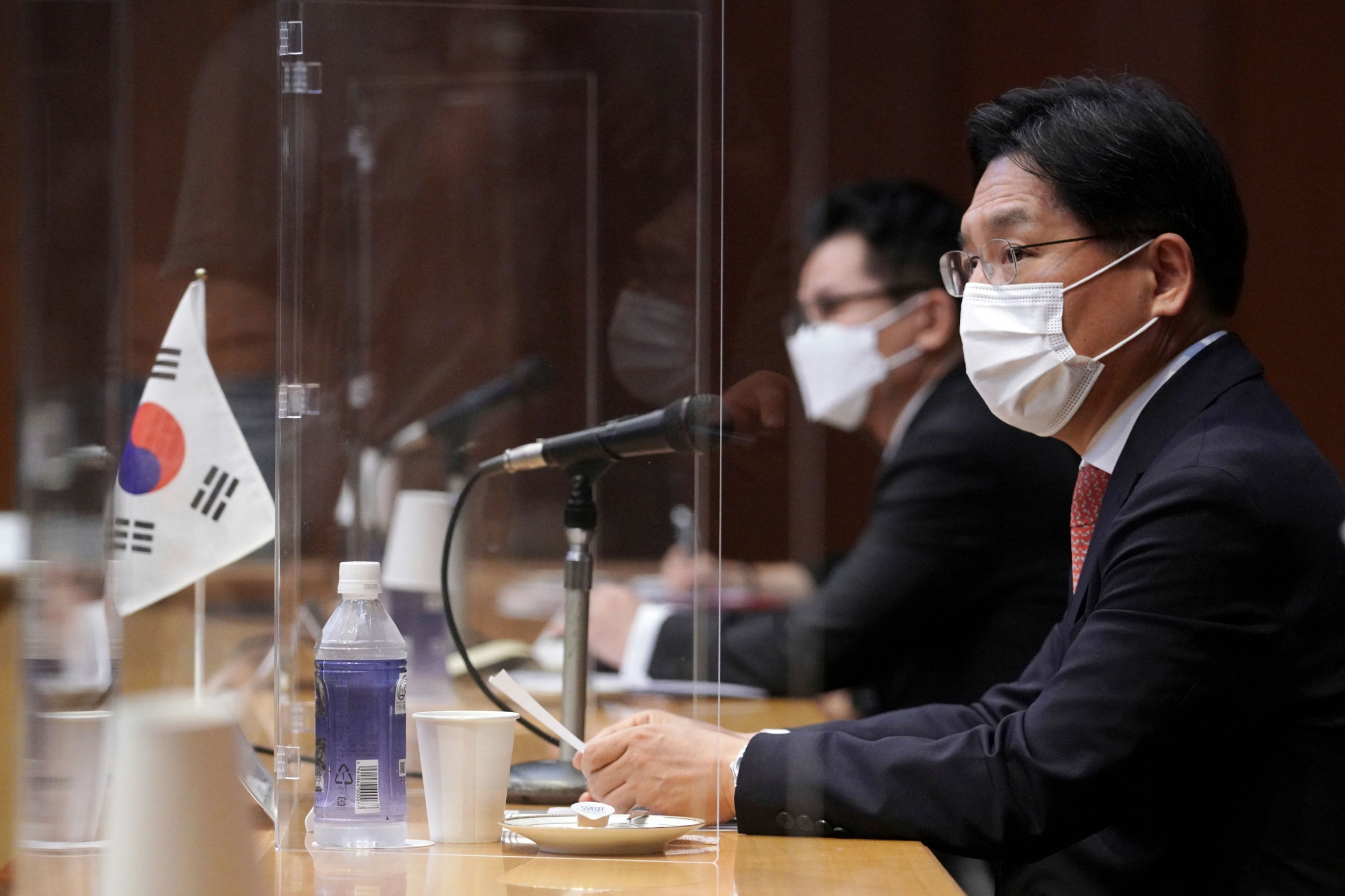 South Korea's Special Representative for Korean Peninsula Peace and Security Affairs Noh Kyu-duk, right, speaks during a trilateral meeting with Japanese Foreign Ministry'sDirector-General of the Asian and Oceanian Affairs Bureau Takehiro Funakoshi, and