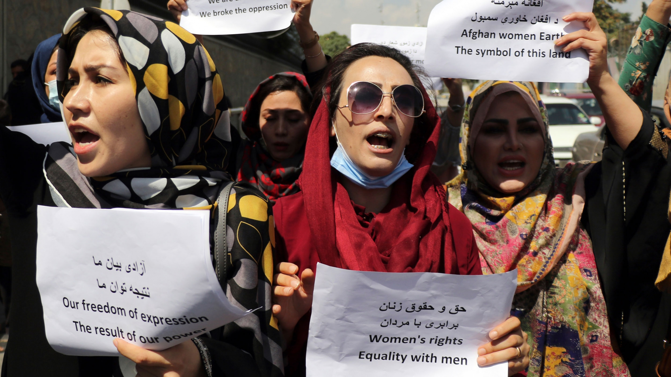 Women gather to demand their rights under the Taliban rule during a protest in Kabul, Afghanistan, Friday, Sept. 3, 2021.