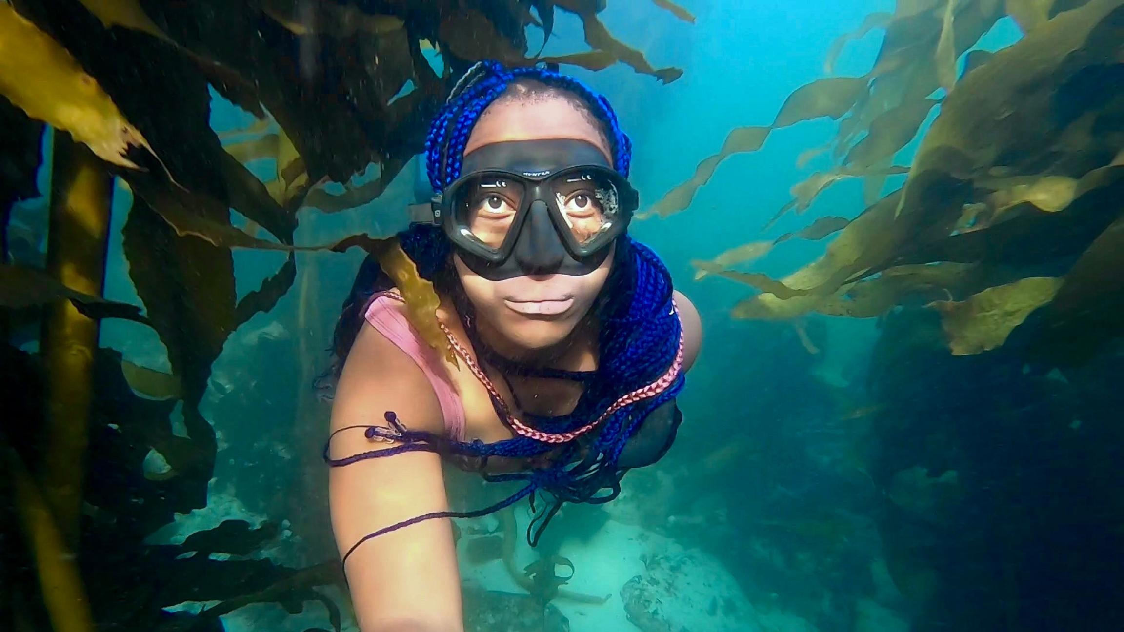 "South Africa's ""Black Mermaid,"" Zandile Ndhlovu, enjoys sunrise dives in the kelp forest."