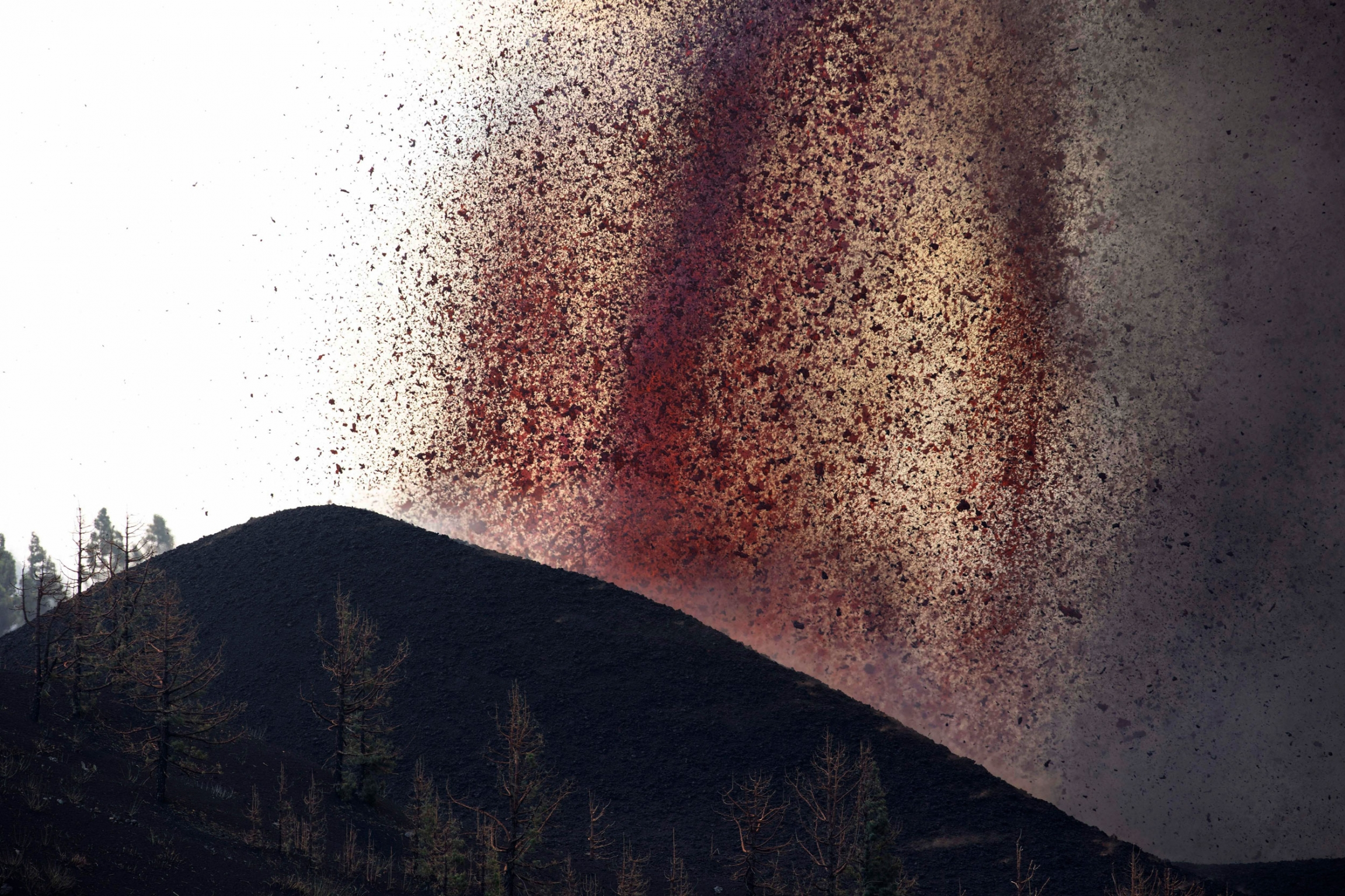 Lava flows from an eruption of a volcano near El Paso on the island of La Palma in the Canaries, Spain, of Monday, Sept. 20, 2021.