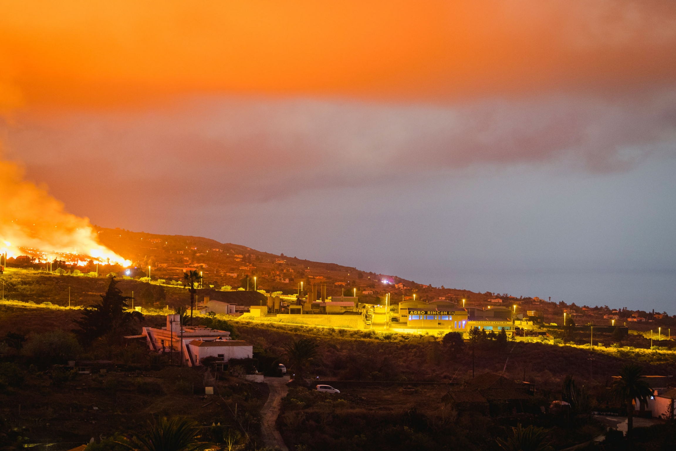 Lava flows from an eruption of a volcano near El Paso on the island of La Palma in the Canaries, Spain, in the early hours of Monday, Sept. 20, 2021.