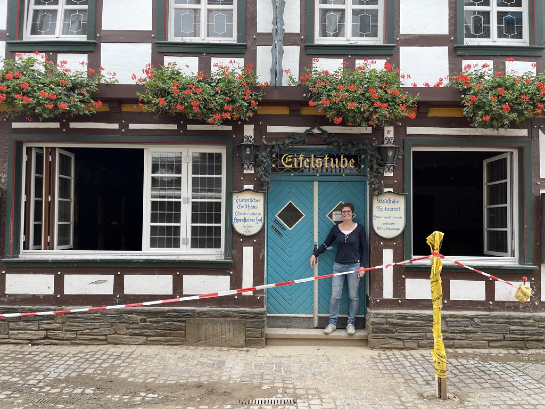 Manuela Schumacher stands amid the ruins of her Eifelstube Restaurant in Bad Neuenahr-Ahrweiler in western Germany in the aftermath of the flood.
